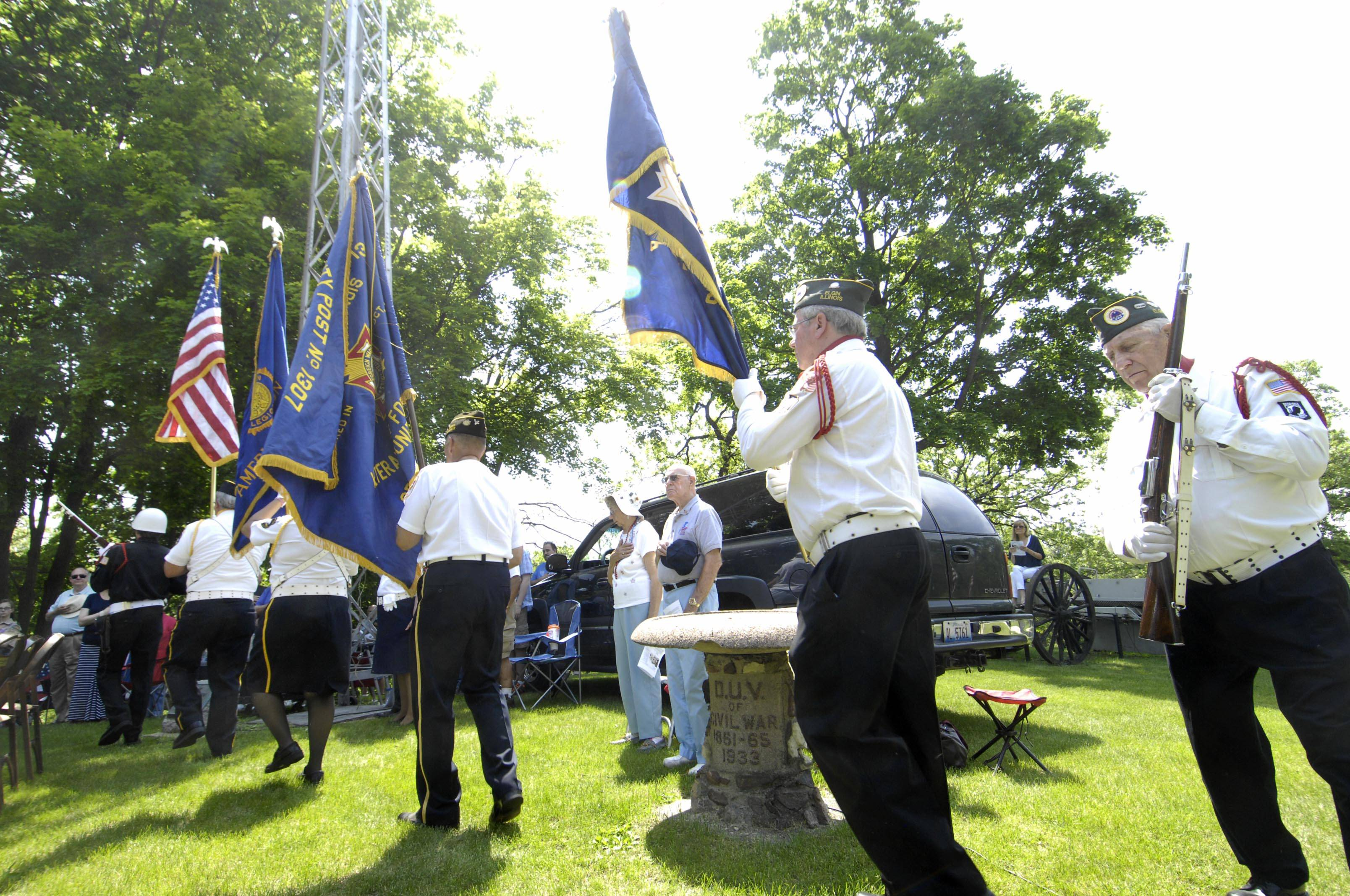 A combined Color Guard marches into the Elgin's Memorial Day event at Bluff City Cemetery Monday.