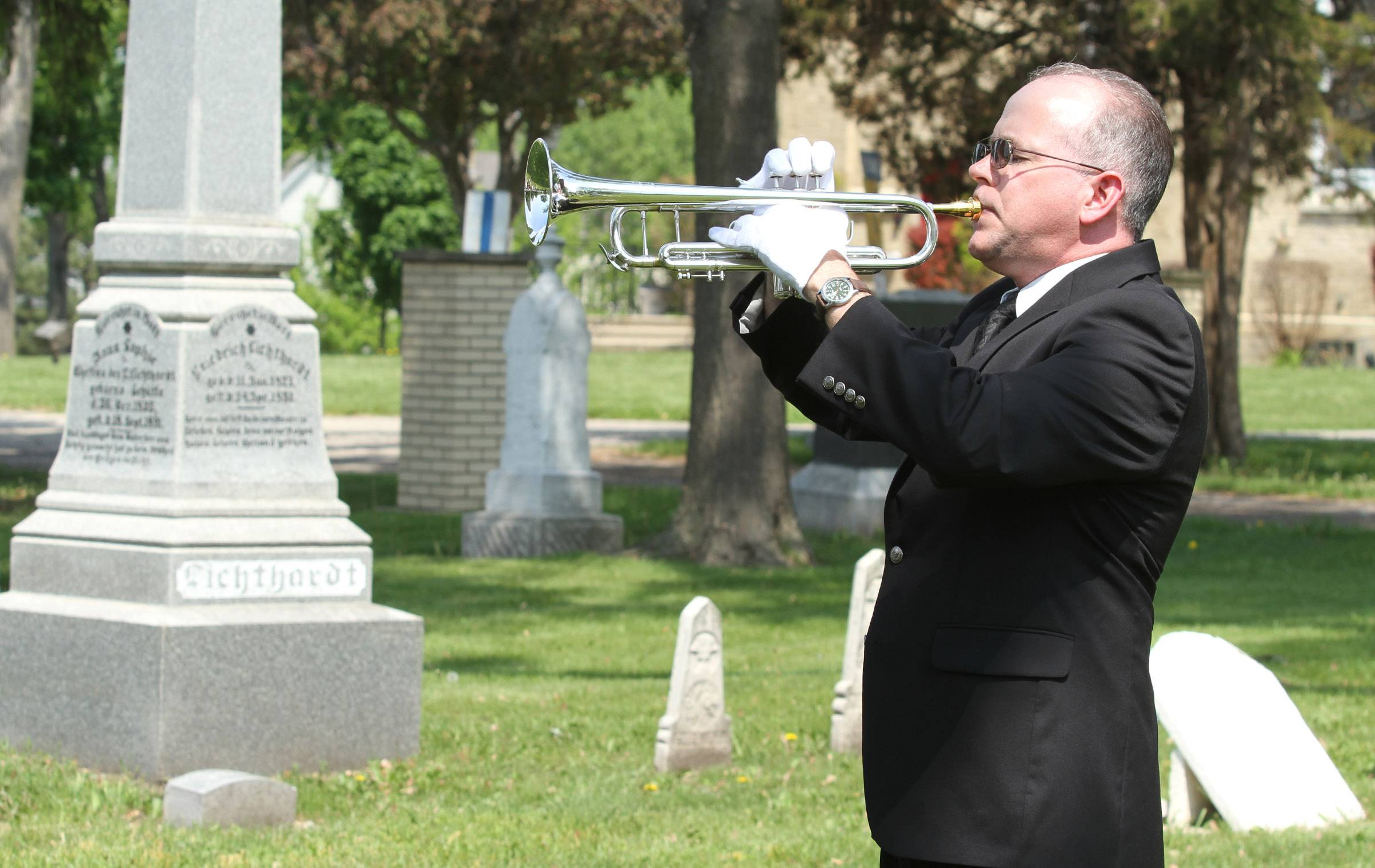 Steve Foster of Hoffman Estates, with Spring Valley Concert Band, plays during a Memorial Day ceremony in St. Peter Lutheran Cemetery in Schaumburg.
