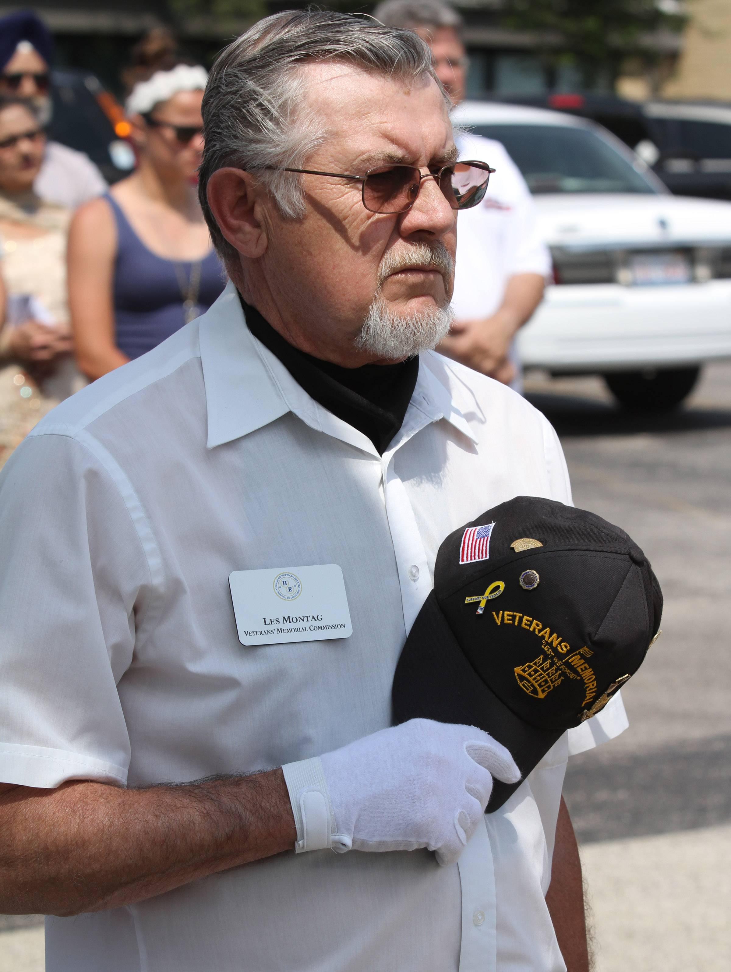 Les Montag with the Veterans' Memorial Commission holds his hat over his heart during a prayer by reverend Jerry Hays, senior pastor at St. Peter Lutheran Church, during a Memorial Day ceremony at St. Peter Lutheran Cemetery in Schaumburg.