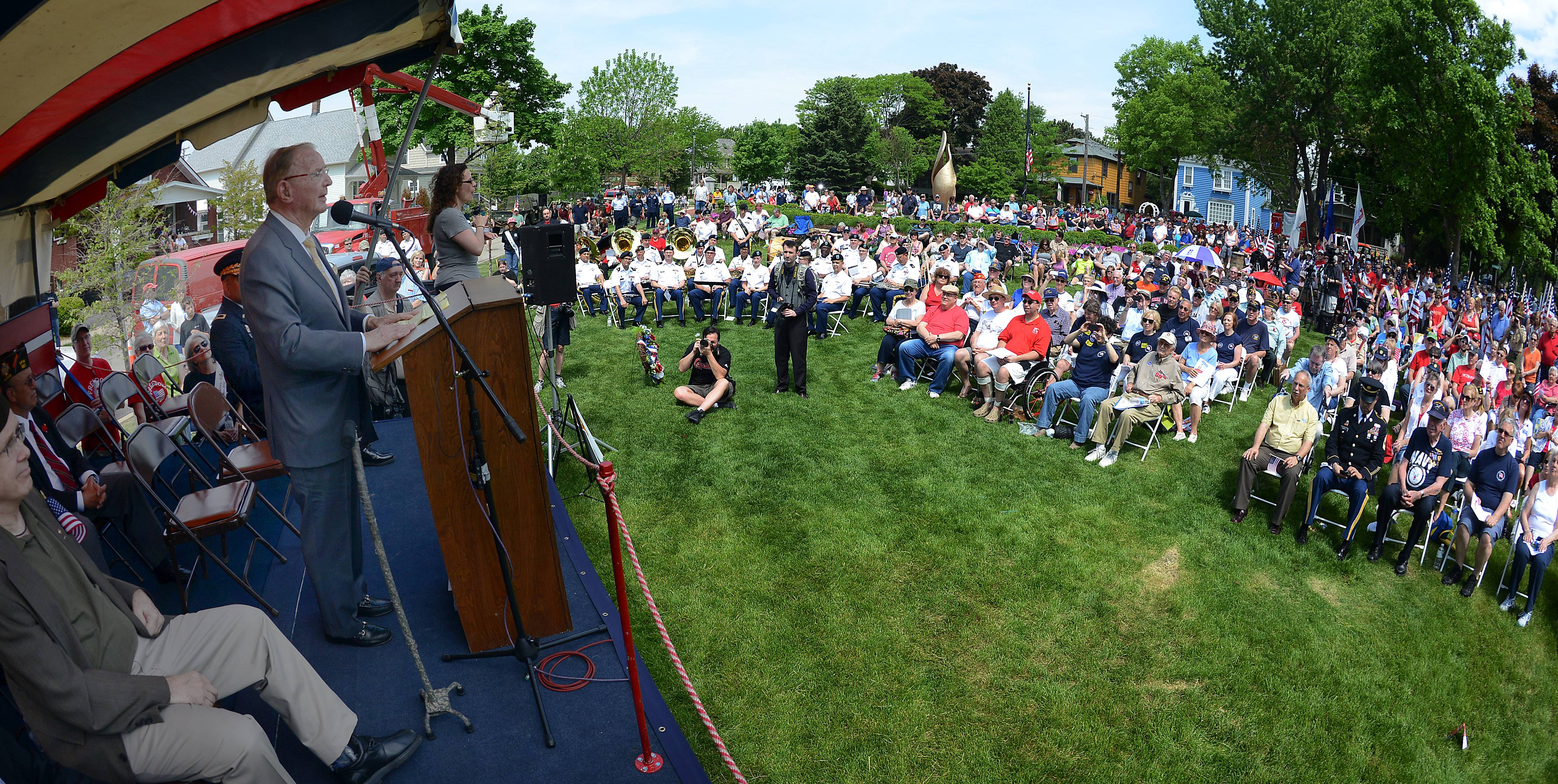 Richard Duchossois, grand marshall of the parade and World War II veteran speaks to his fellow veterans at the Arlington Heights Memorial Day ceremony on Monday.