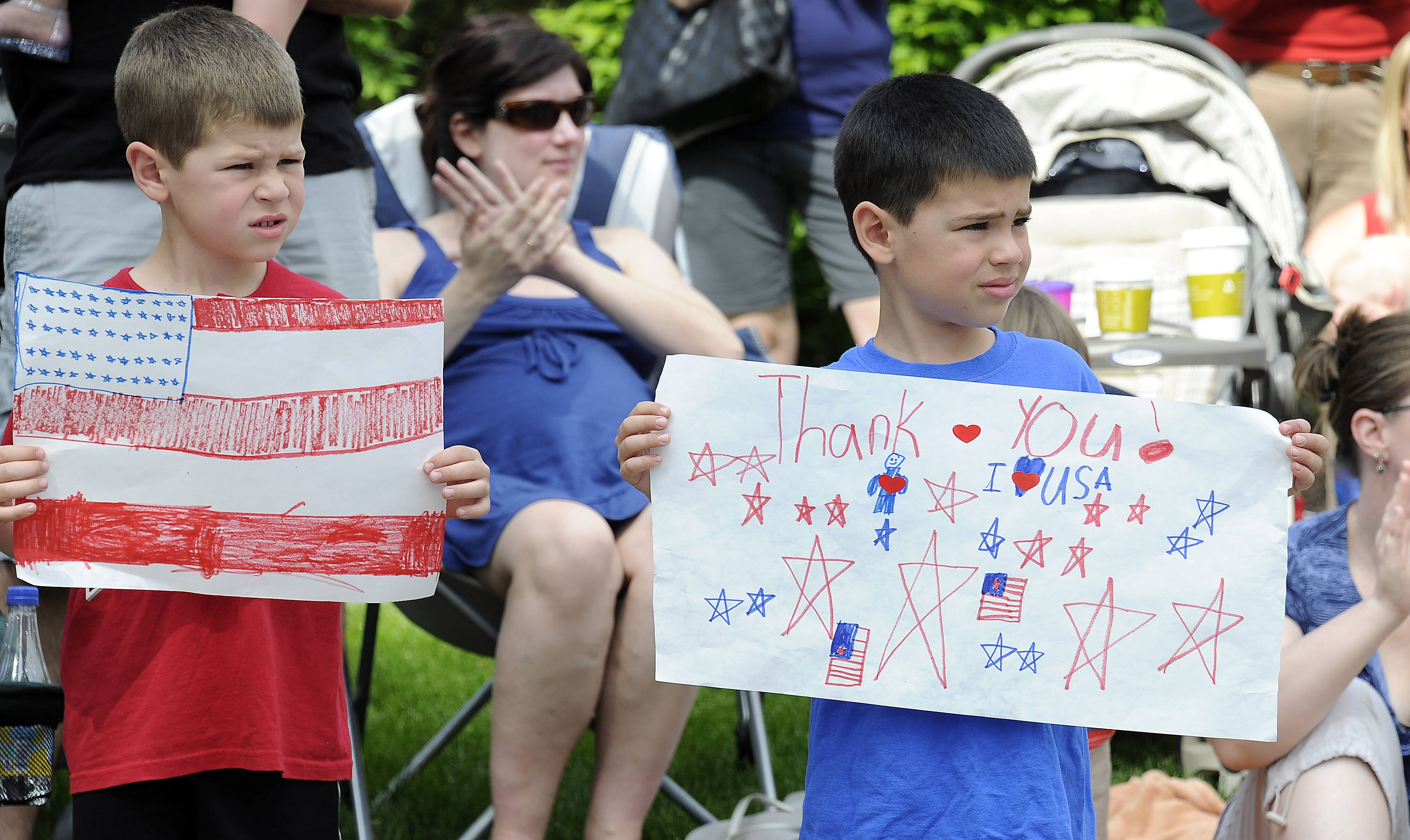 Ben, 5, and Anthony Zebron, 6, show their support at the Arlington Heights Memorial Day parade on Monday.