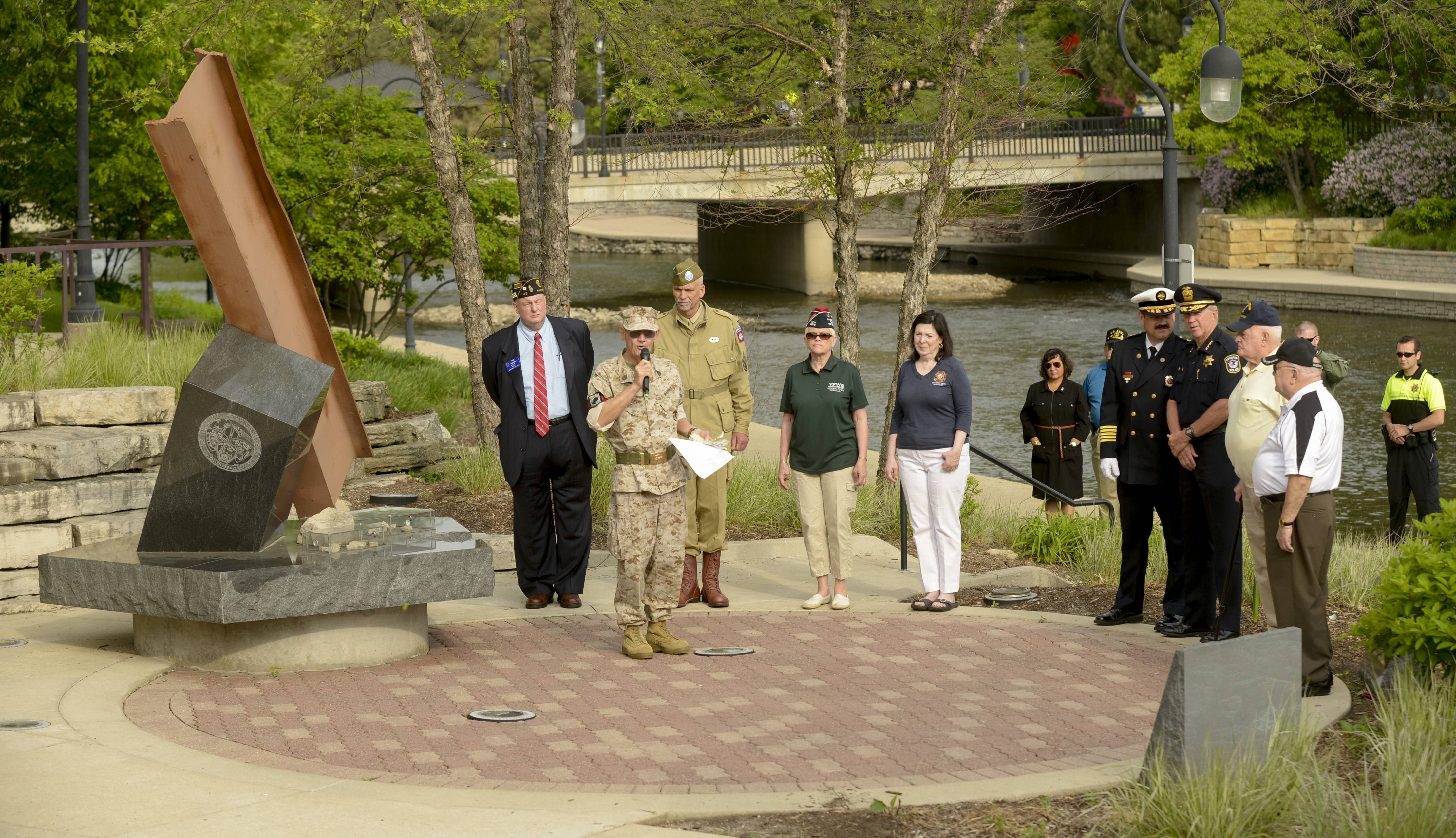 Naperville conducts a Memorial Day service at the Cmdr. Dan Shanower/Sept. 11 memorial, Monday.