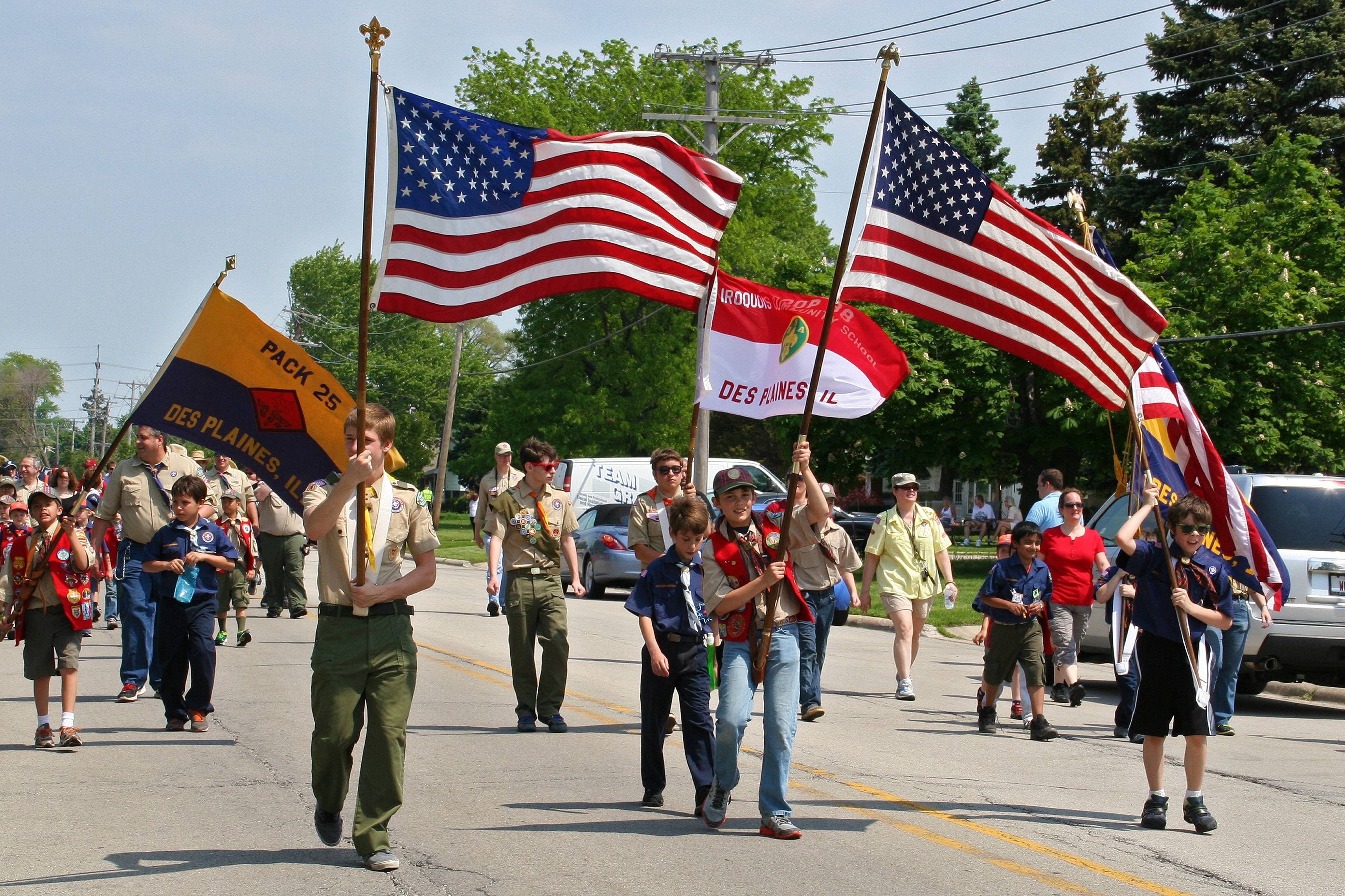 (Left to Right) Cub Scout Pack 25, Boy Scout Troop 38, and Cub Scout Pack 997 lead the Memorial Day Parade down Lee Street to the Lake Park Memorial Pavilion on May 26.