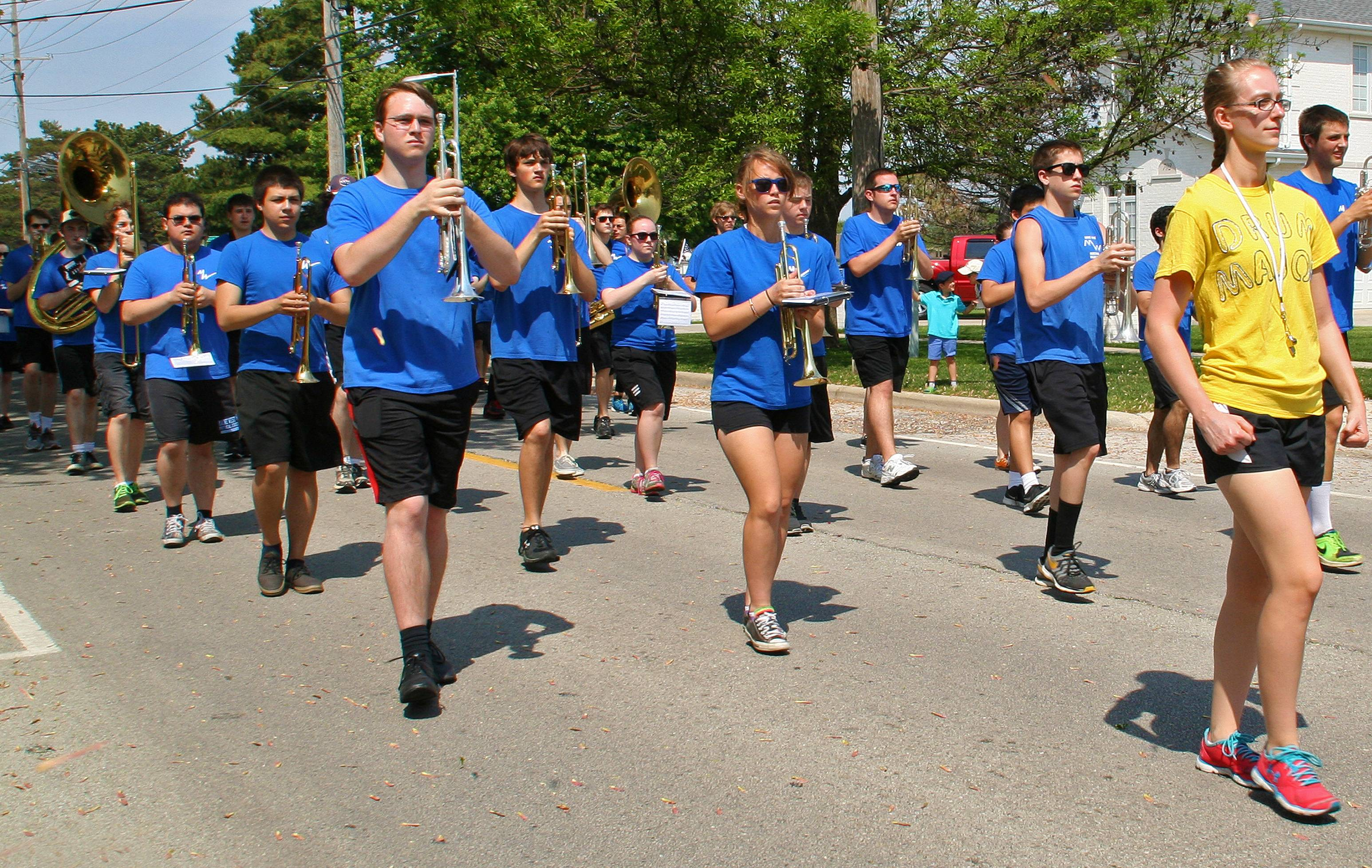 Drum Major Megan Bricks leads the Maine West High School Warriors Marching Band to the Memorial Day Ceremony at the Lake Park Memorial Pavilion on May 26.
