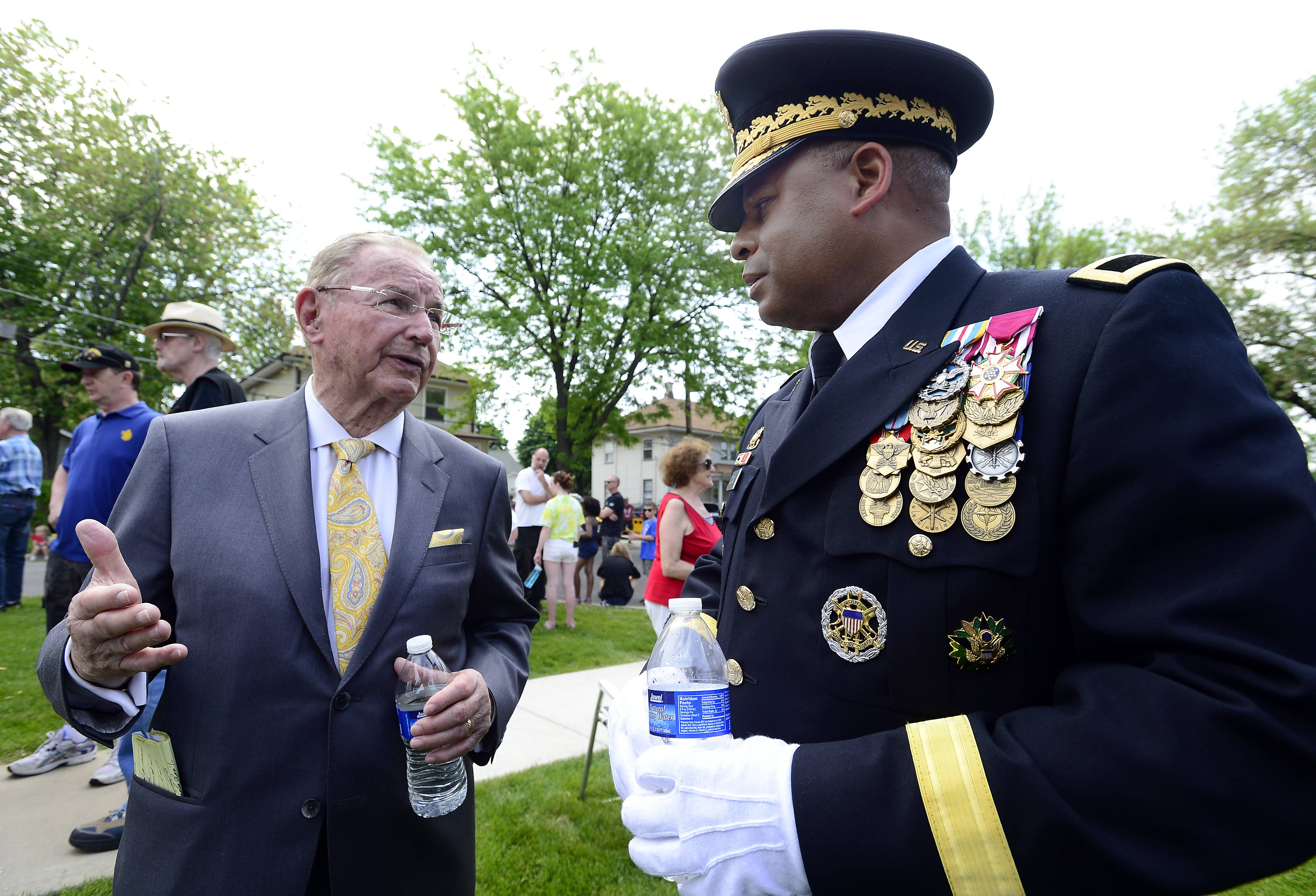 Richard Duchossois, grand marshall of the parade and World War II veteran talks Gracus Dunn, Brigadier General, U.S. Army before the start of the ceremony at the Arlington Heights Memorial Day event on Monday.