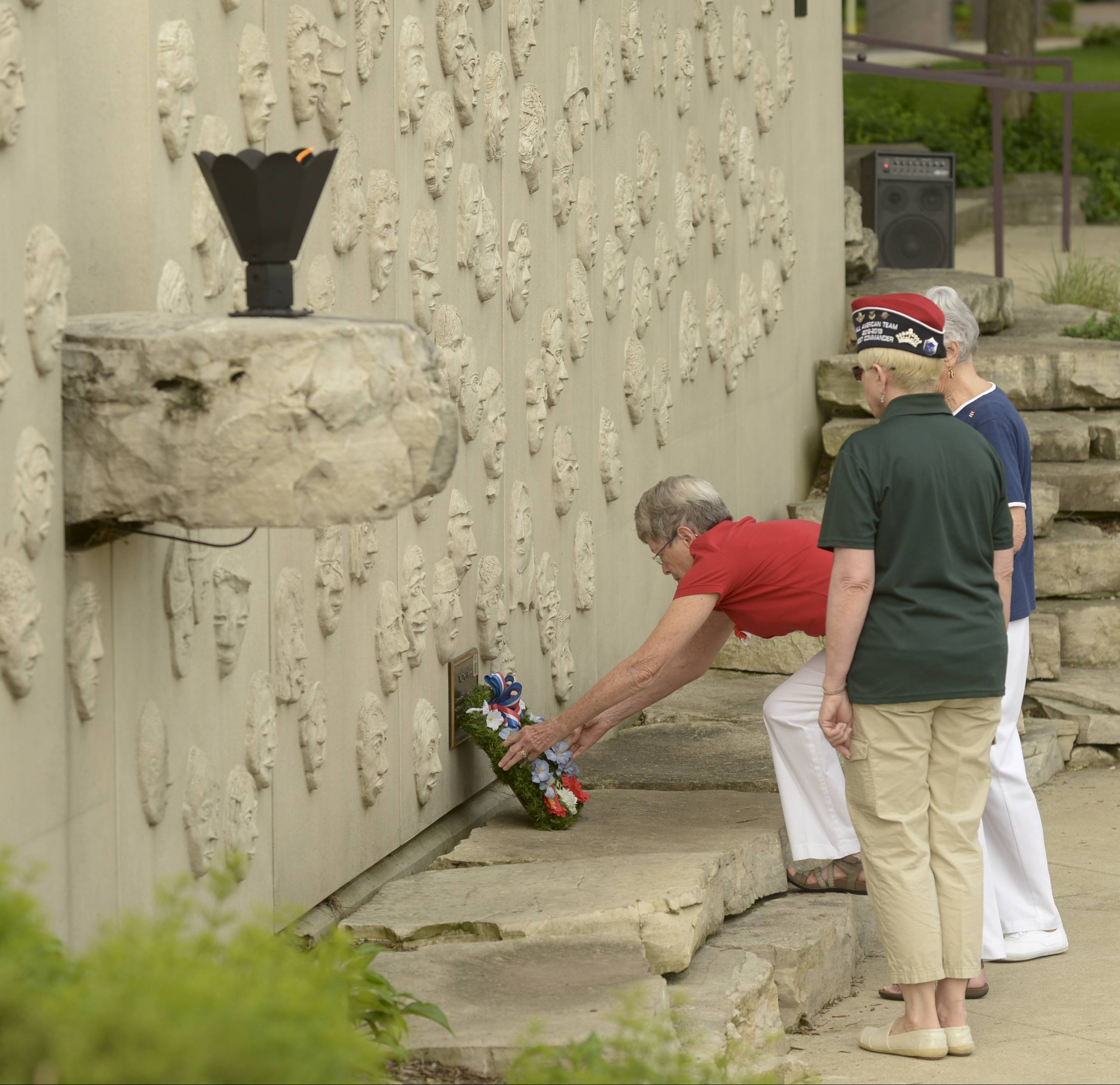 Pat Shanower places a wreath at the memorial named for her son Dan, who was killed in the Sept 11 attacks while working at the Pentagon, during Naperville's Memorial Day service.