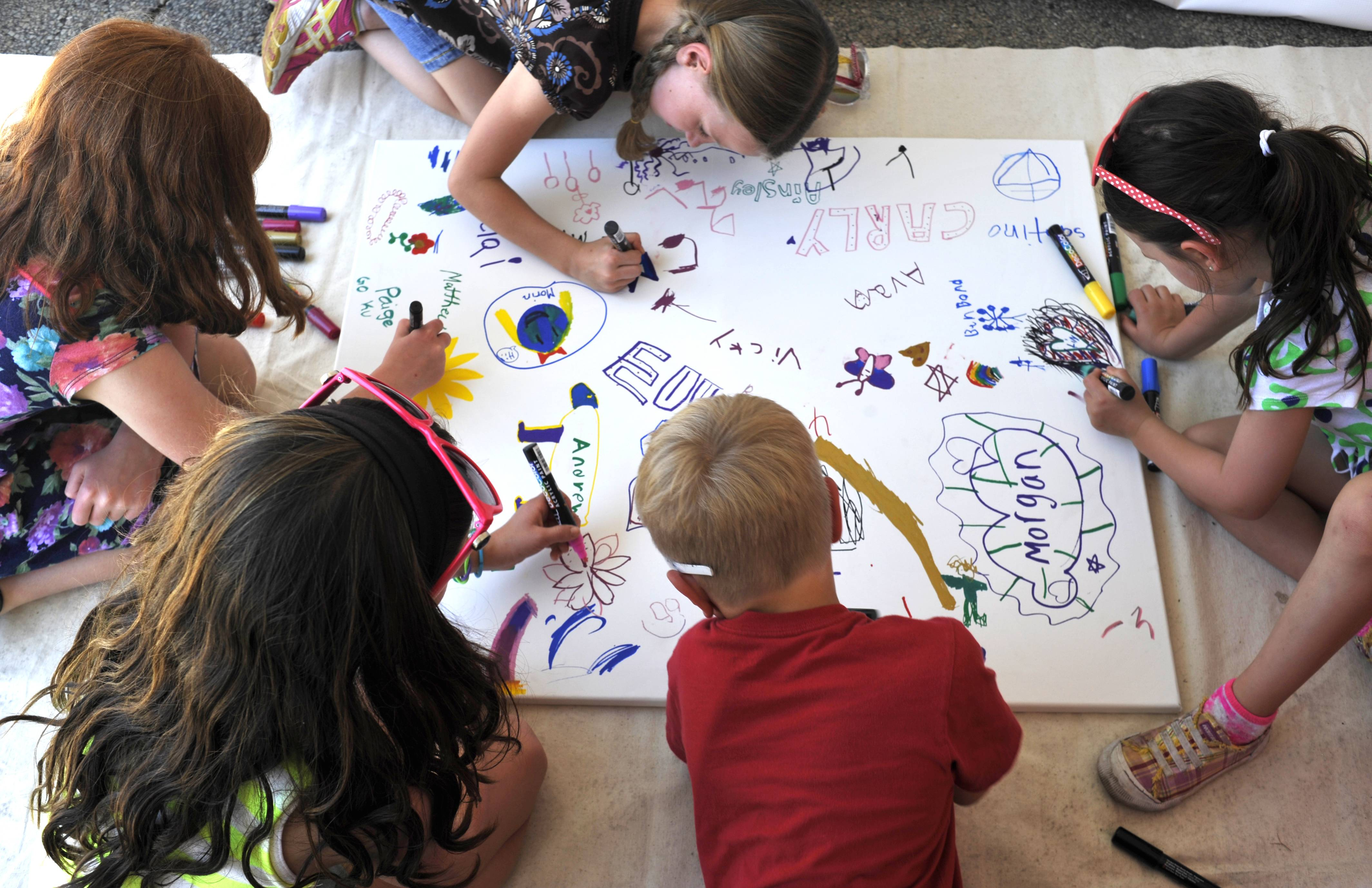 Sara House, 6, Molly Denz, 9, Ella Ruff, 9, Josh Denz, 7 and Lily Ruff, 6, (clockwise from far left) all of St. Charles, create drawings together at the St. Charles Fine Arts Festival on Sunday in downtown St. Charles.