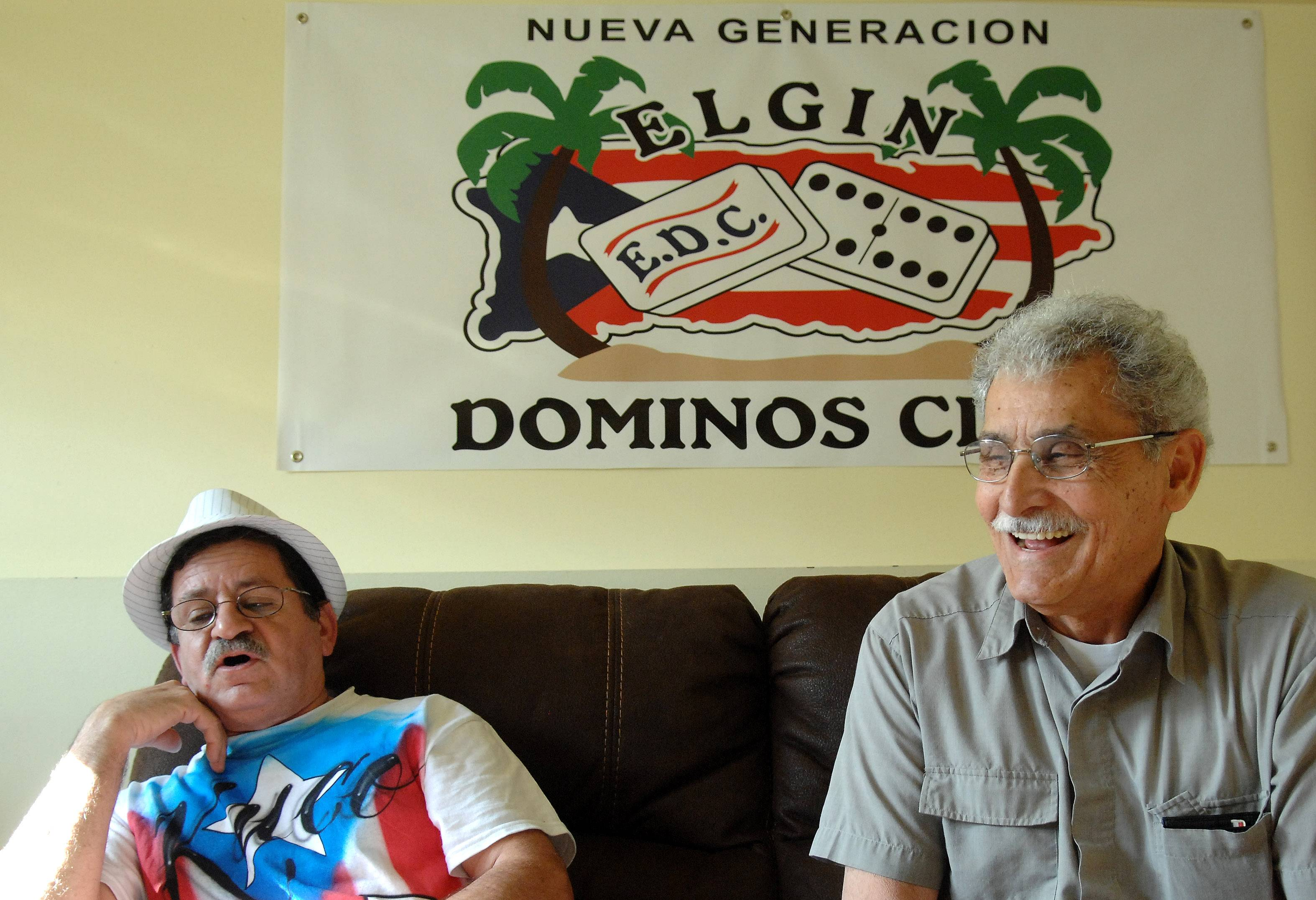 "Alfredo ""Cuco"" Garcia, left, and Celestino Hernandez, both of Elgin, have been domino partners for about 20 years."