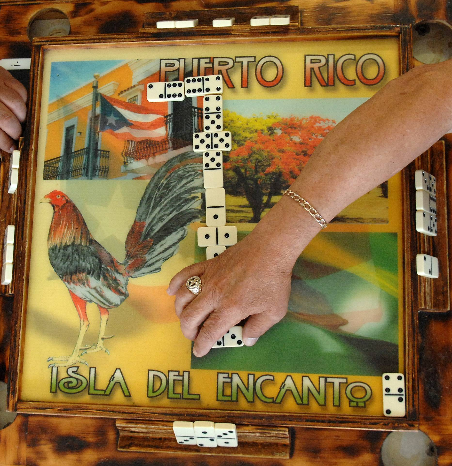 "Alfredo ""Cuco"" Garcia of Elgin owns handcrafted domino tables from Puerto Rico."