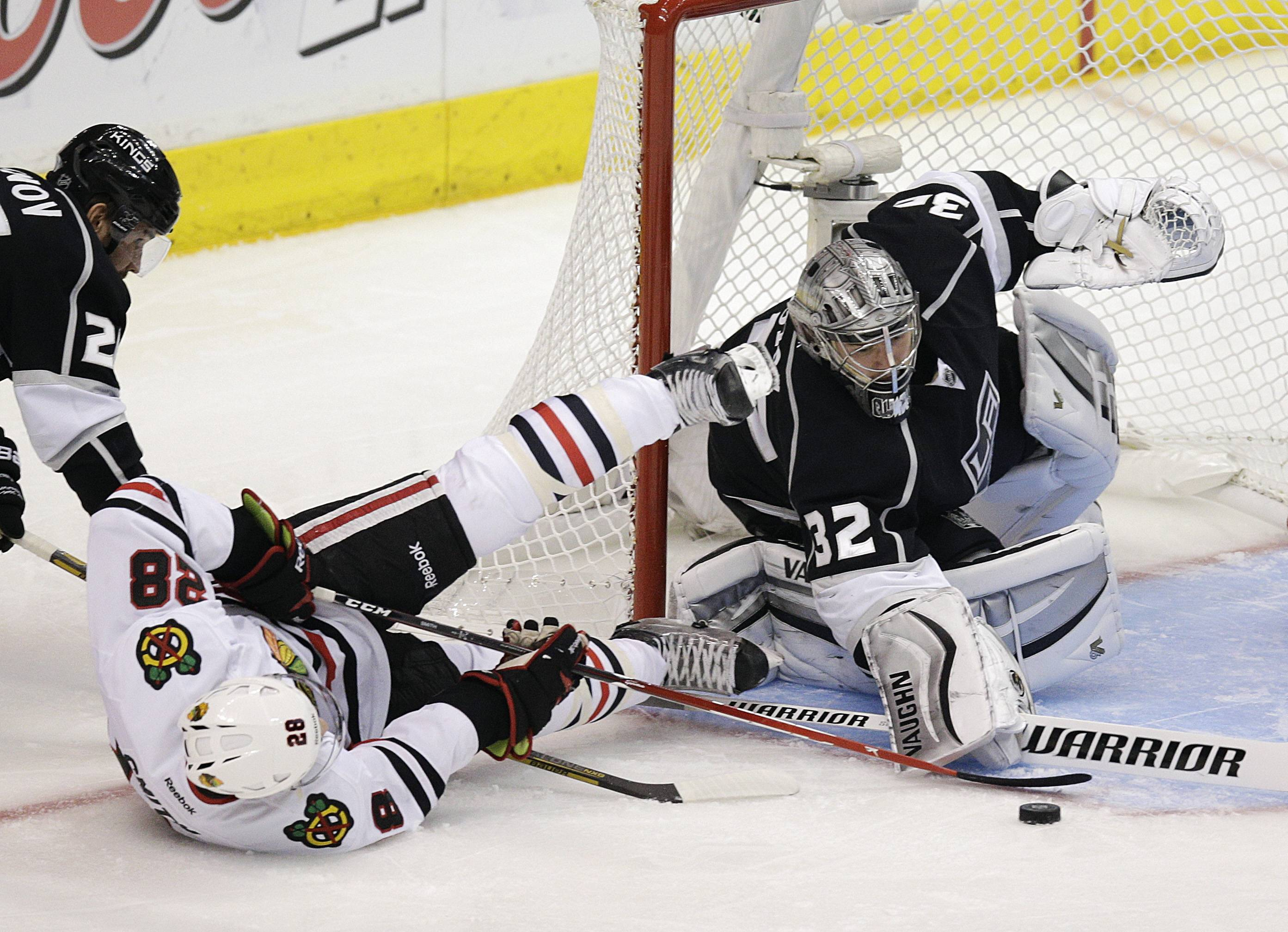 Los Angeles Kings goalie Jonathan Quick, right, stops a shot by Chicago Blackhawks' Ben Smith during the second period of Game 4 Monday in Los Angeles.