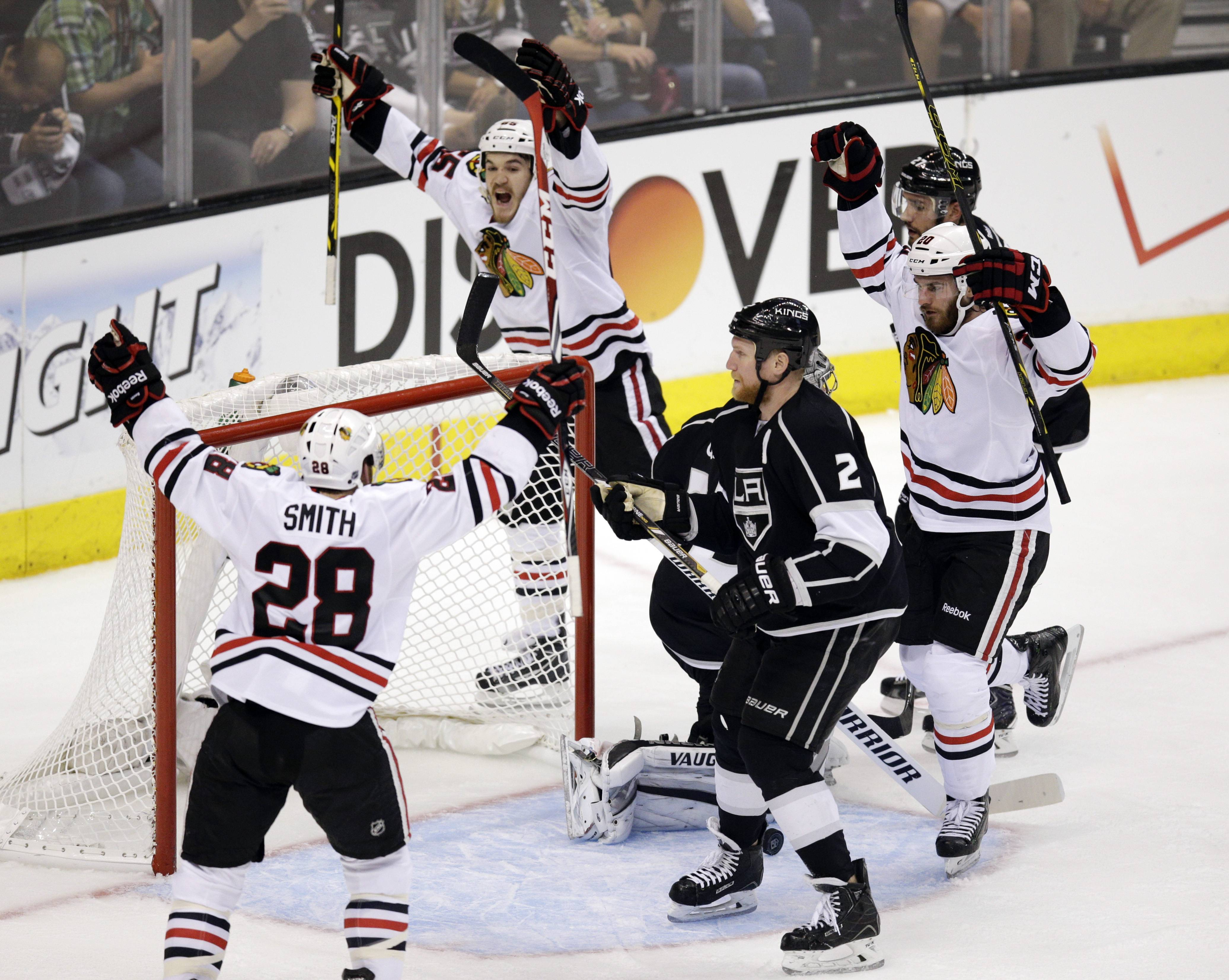 Chicago Blackhawks' Brandon Saad, right, celebrates his goal with Ben Smith, left, and Andrew Shaw, background center during the second period of Game 4 of the Western Conference final in Los Angeles.