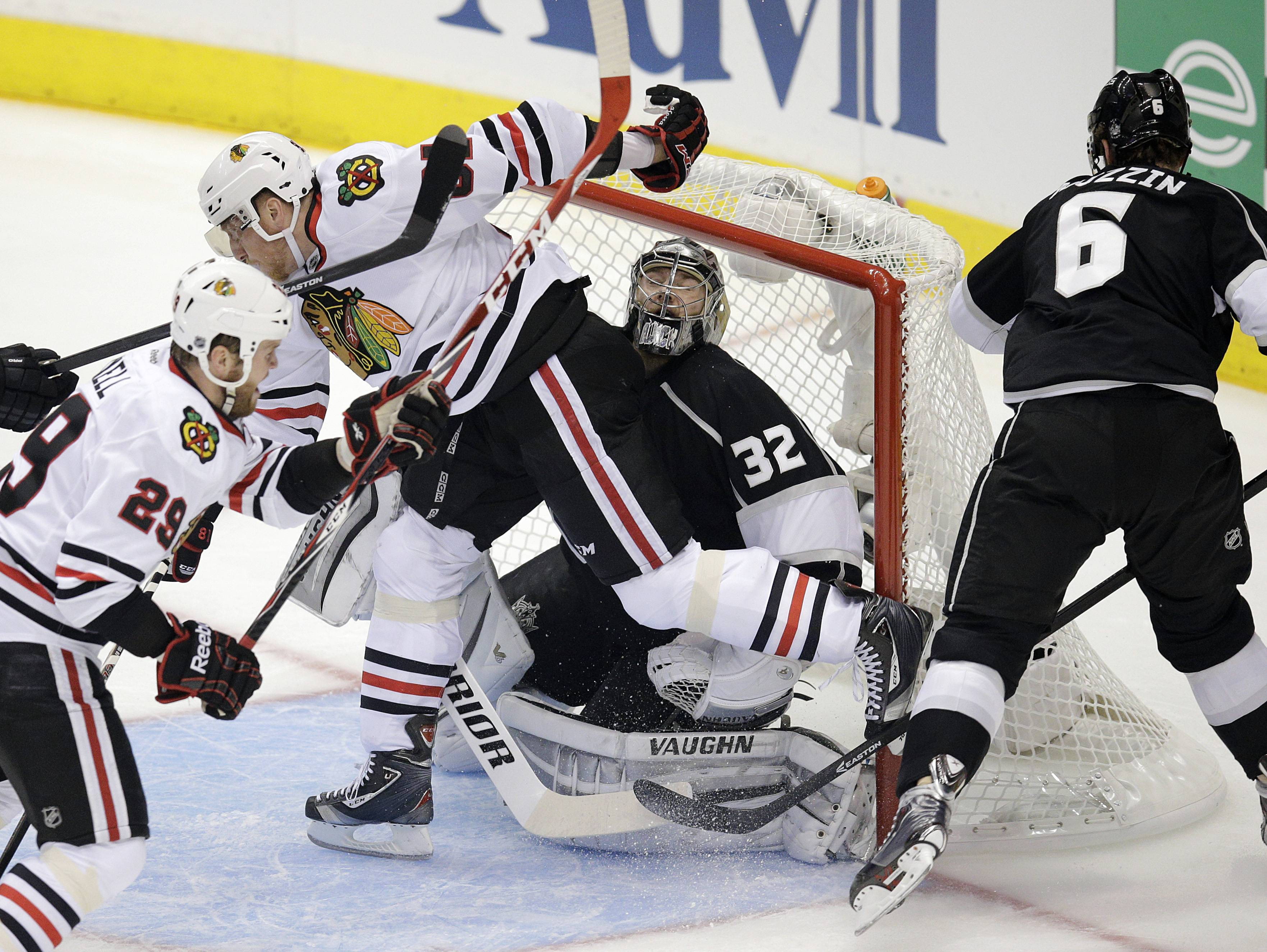 Chicago Blackhawks' Marian Hossa, center left, of Slovakia, collides with Los Angeles Kings goalie Jonathan Quick, second from right, during the first period of Game 4 of the Western Conference finals of the NHL hockey Stanley Cup playoffs on Monday, May 26, 2014, in Los Angeles.