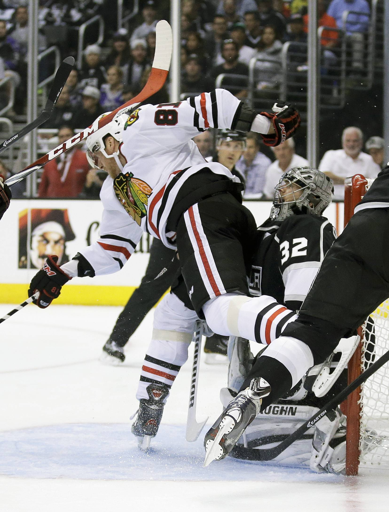 Chicago Blackhawks right wing Marian Hossa, left, collides with Los Angeles Kings goalie Jonathan Quick during the first period of Game 4 of the Western Conference finals of the NHL hockey Stanley Cup playoffs in Los Angeles, Monday, May 26, 2014.