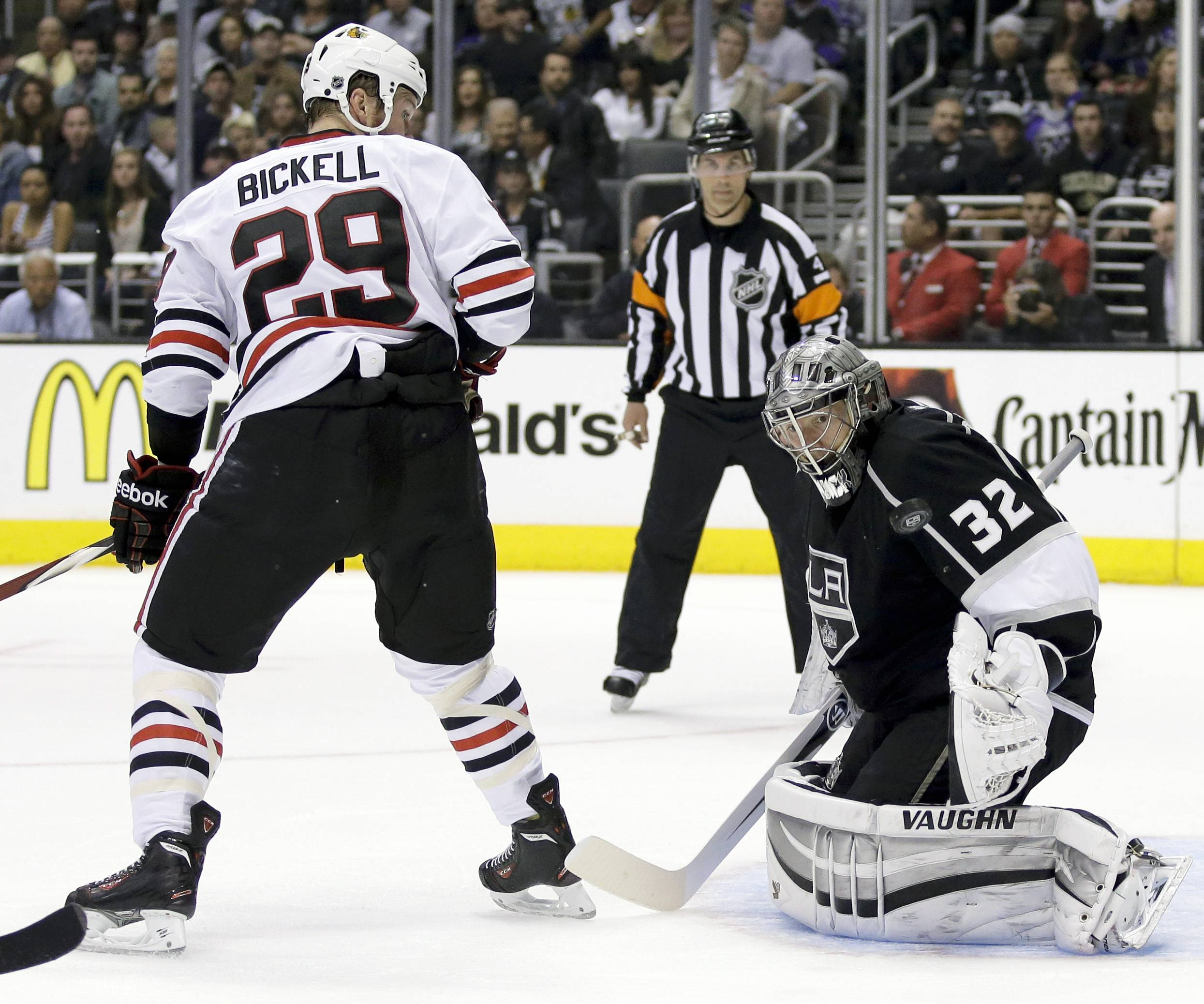 Los Angeles Kings goalie Jonathan Quick, right, blocks a shot as Chicago Blackhawks left wing Bryan Bickell stands near during the first period of Game 4 of the Western Conference finals of the NHL hockey Stanley Cup playoffs in Los Angeles, Monday, May 26, 2014.