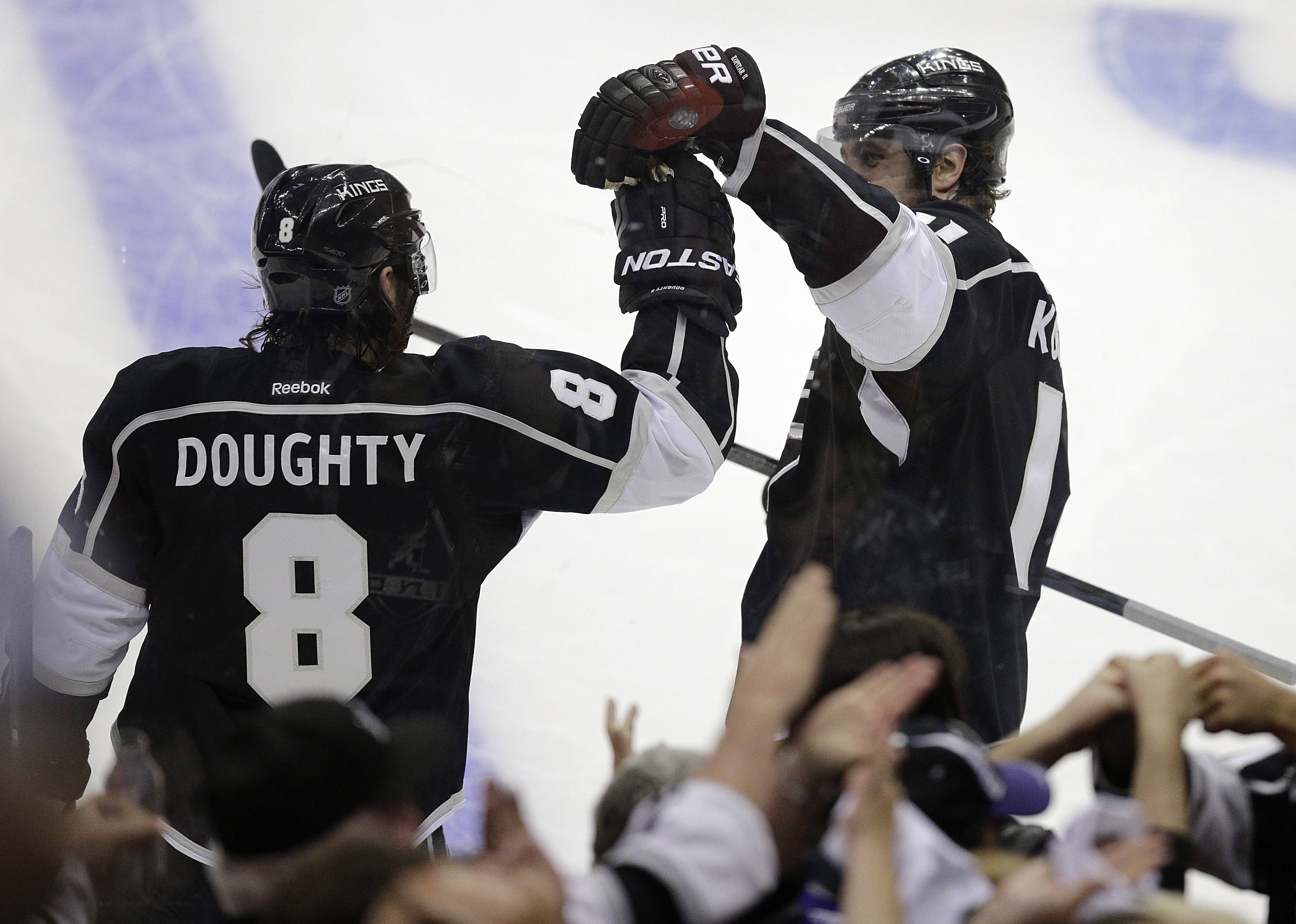 Los Angeles Kings' Drew Doughty, left, is congratulated by Anze Kopitar, of Slovenia, after scoring against the Chicago Blackhawks during the second period of Game 4 of the Western Conference finals of the NHL hockey Stanley Cup playoffs on Monday, May 26, 2014, in Los Angeles.
