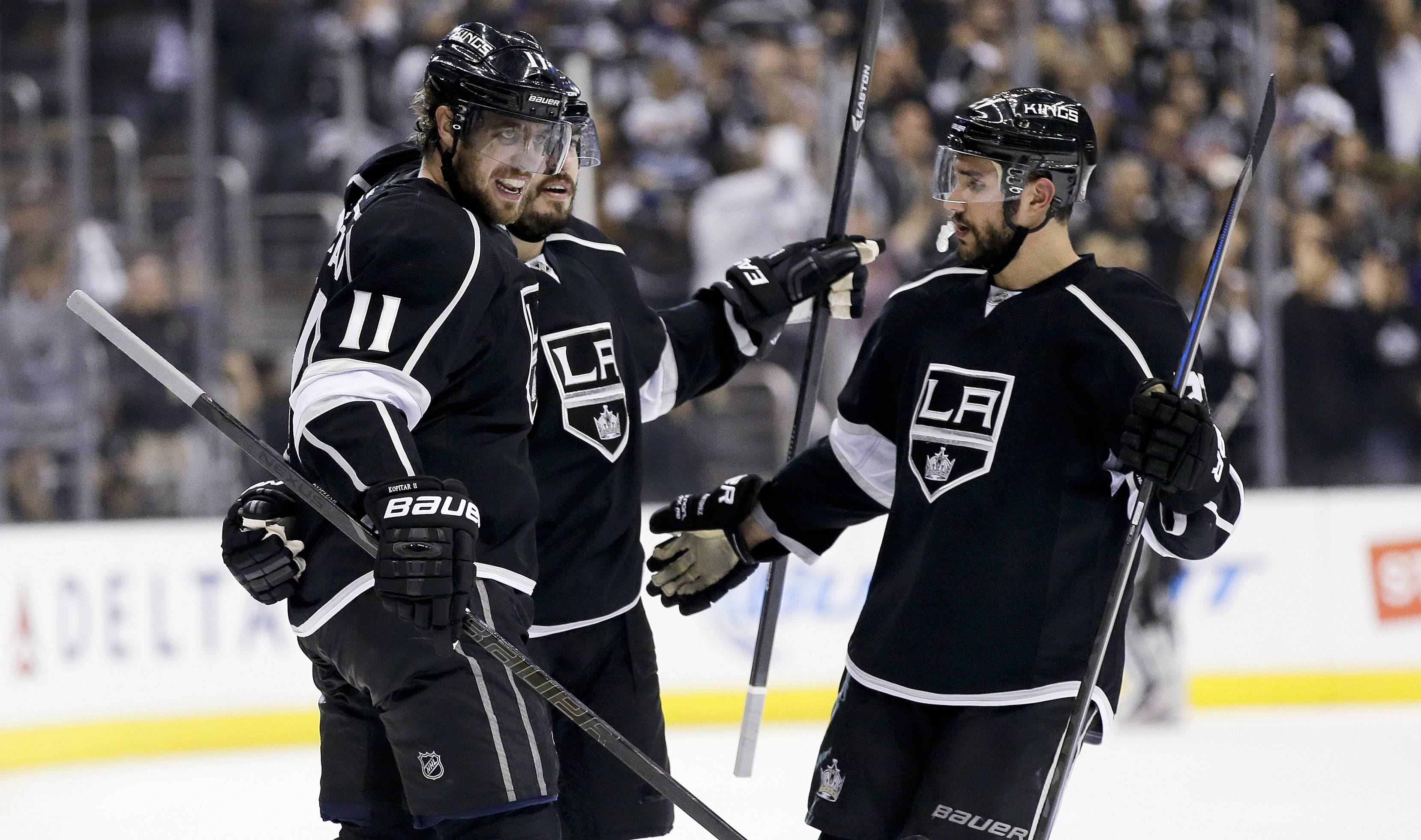 Los Angeles Kings defenseman Drew Doughty, middle, celebrates his goal against the Chicago Blackhawks with center Anze Kopitar, left, and defenseman Alec Martinez during the second period of Game 4 of the Western Conference finals of the NHL hockey Stanley Cup playoffs in Los Angeles, Monday, May 26, 2014.