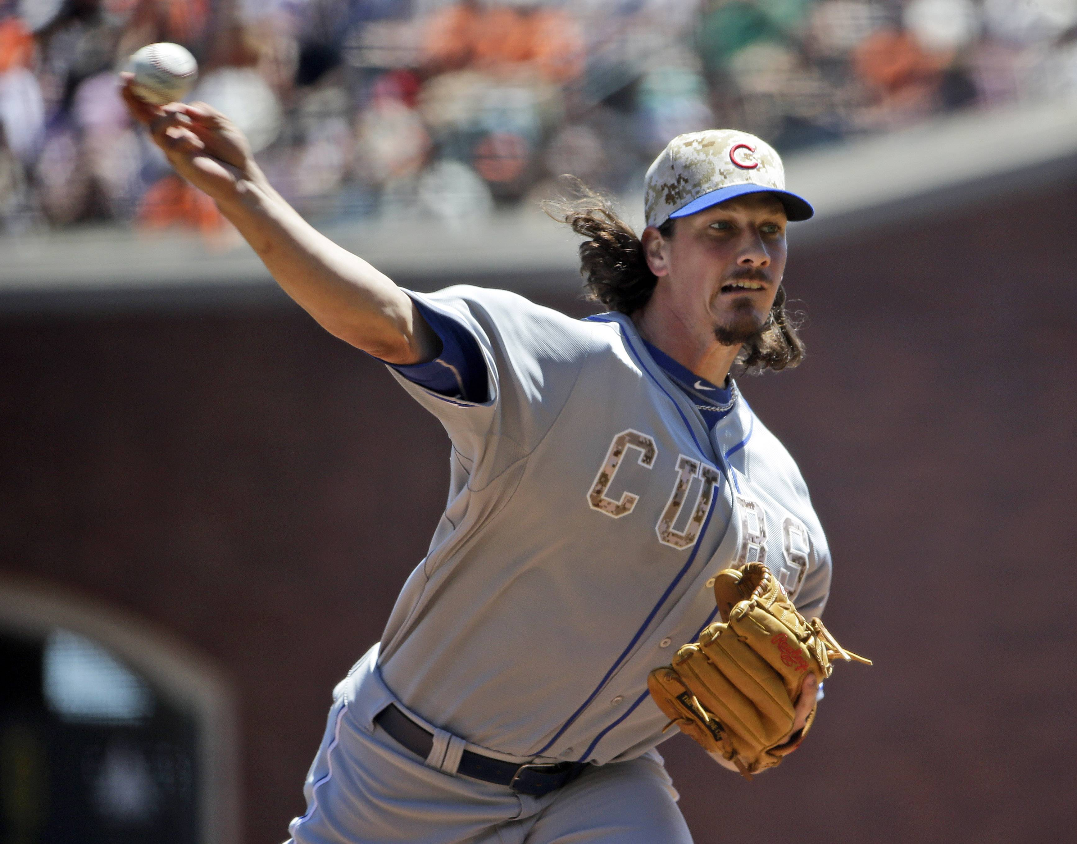 Chicago Cubs starting pitcher Jeff Samardzija throws to the San Francisco Giants during the first inning. This time he got run support and the win.