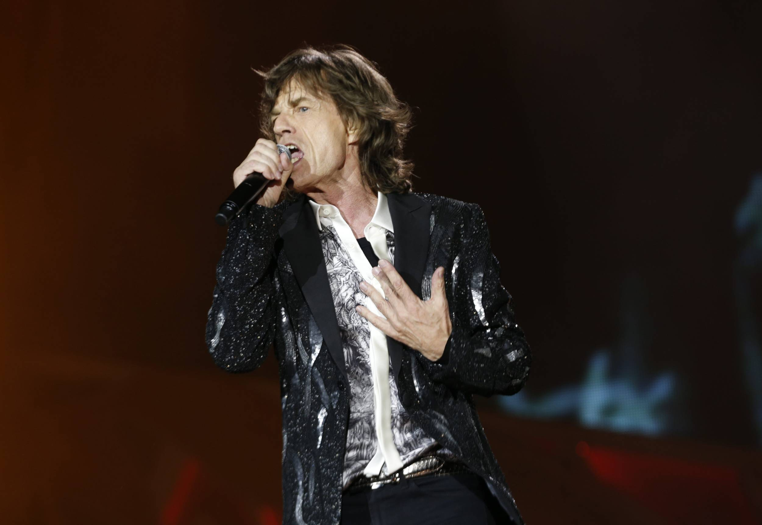 Rolling Stones singer frontman Mick Jagger performs during a concert in the Telenor Arena at Fornebu in Baerum just south of Oslo, Norway, Monday. It was the first time the Rolling Stones have played since the death of Jagger's longtime companion L'Wren Scott died earlier this year.