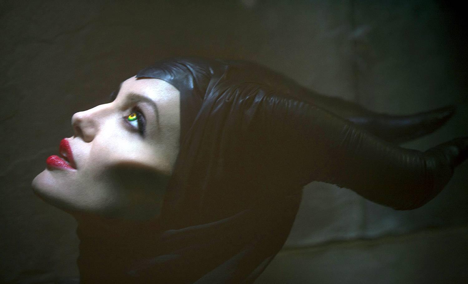 "Angelina Jolie plays the title role of ""Maleficent,"" the villain from the 1959 classic ""Sleeping Beauty."" The film releases in theaters on Friday."