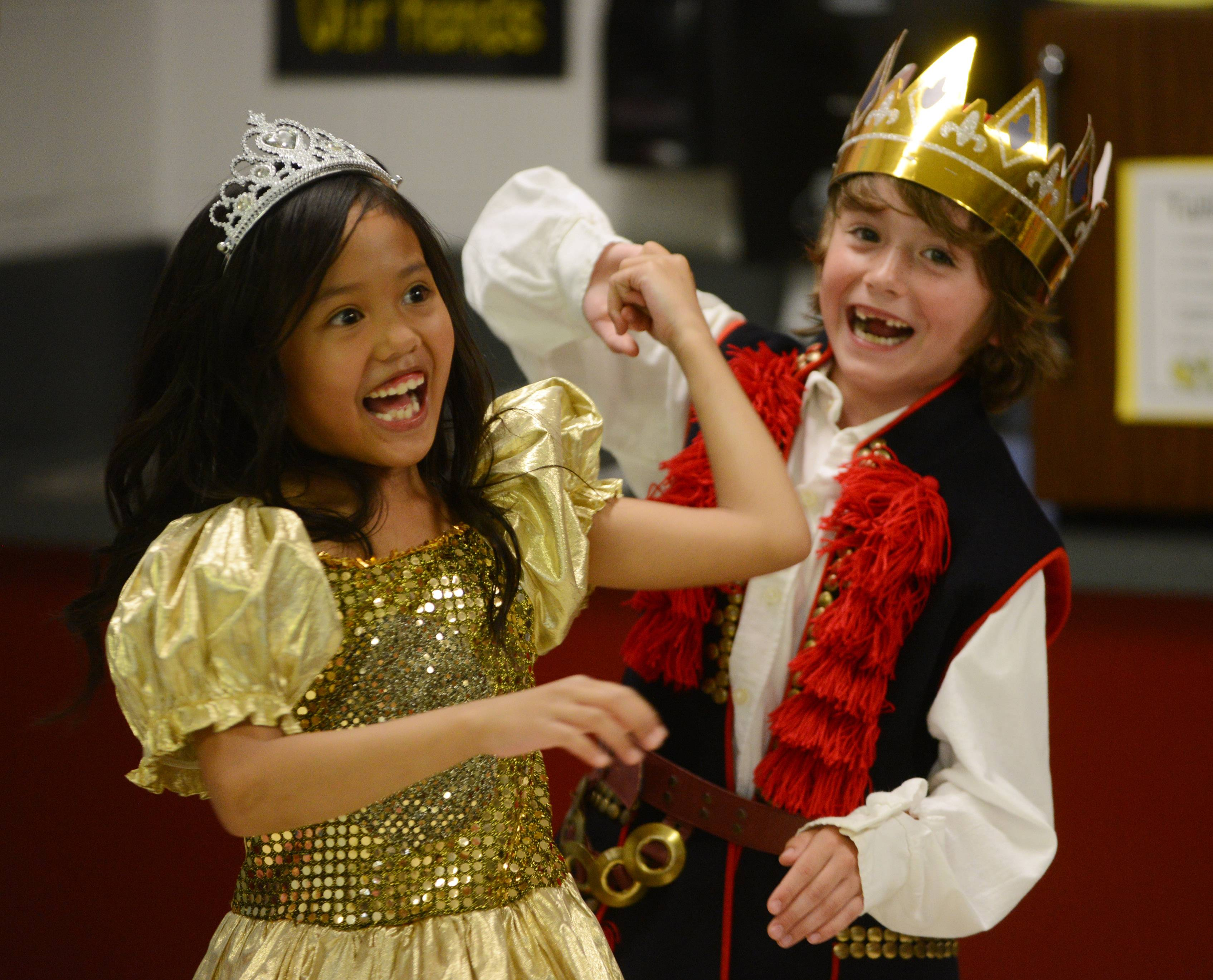 Woodland Elementary East second grade student Abby Mago, left, as Cinderella, and shares a dance with the prince, Bryce Carlton, during Tuesday's Readers Theater at the Gages Lake school. Twenty-one students in Krystyna Jakielski's class presented three stories to parents and siblings.