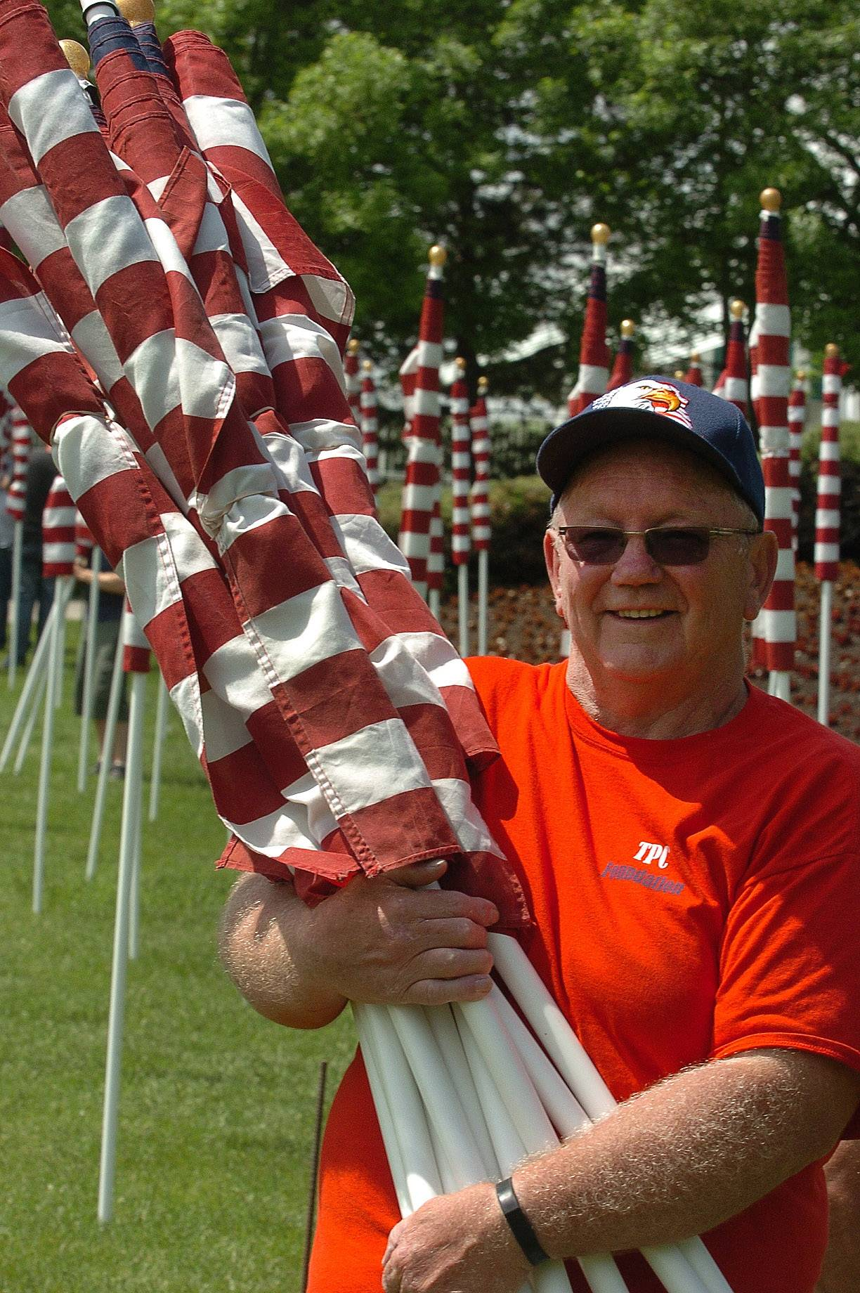 "True Patriots Care Foundation President Jerry Christopherson, along with his volunteers, remove the 323 American flags that made up the ""Field of Honor"" at Arlington International Racecourse. The flags represented each of the Illinois soldiers killed since Sept. 11, 2001."