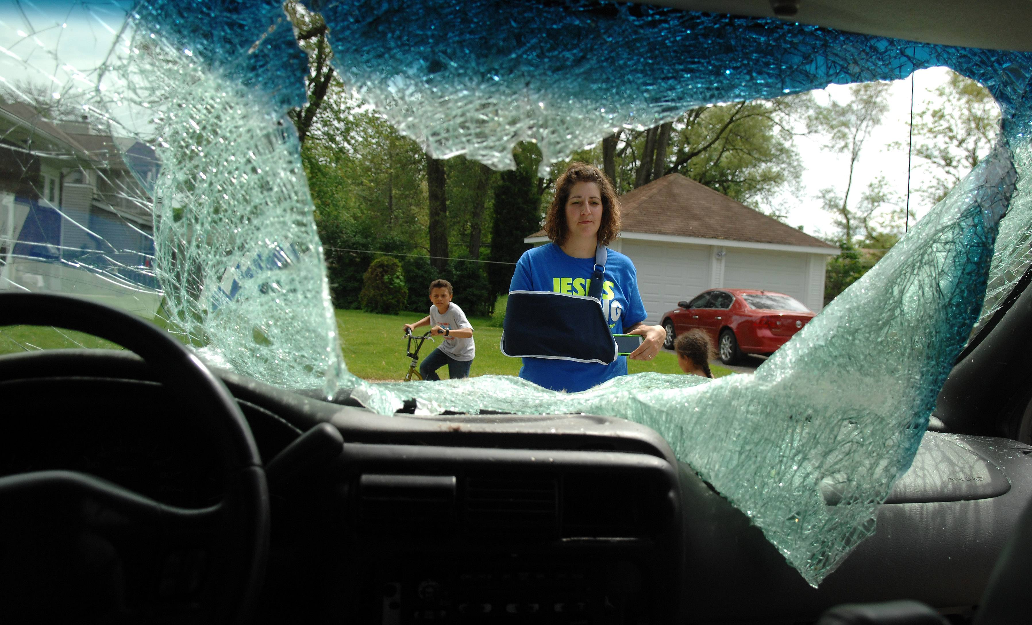 Heidi Conner of West Dundee describes how a deer jumped off an overpass and crashed through the windshield of her Chevrolet Venture minivan Sunday while driving on the Jane Addams Tollway.