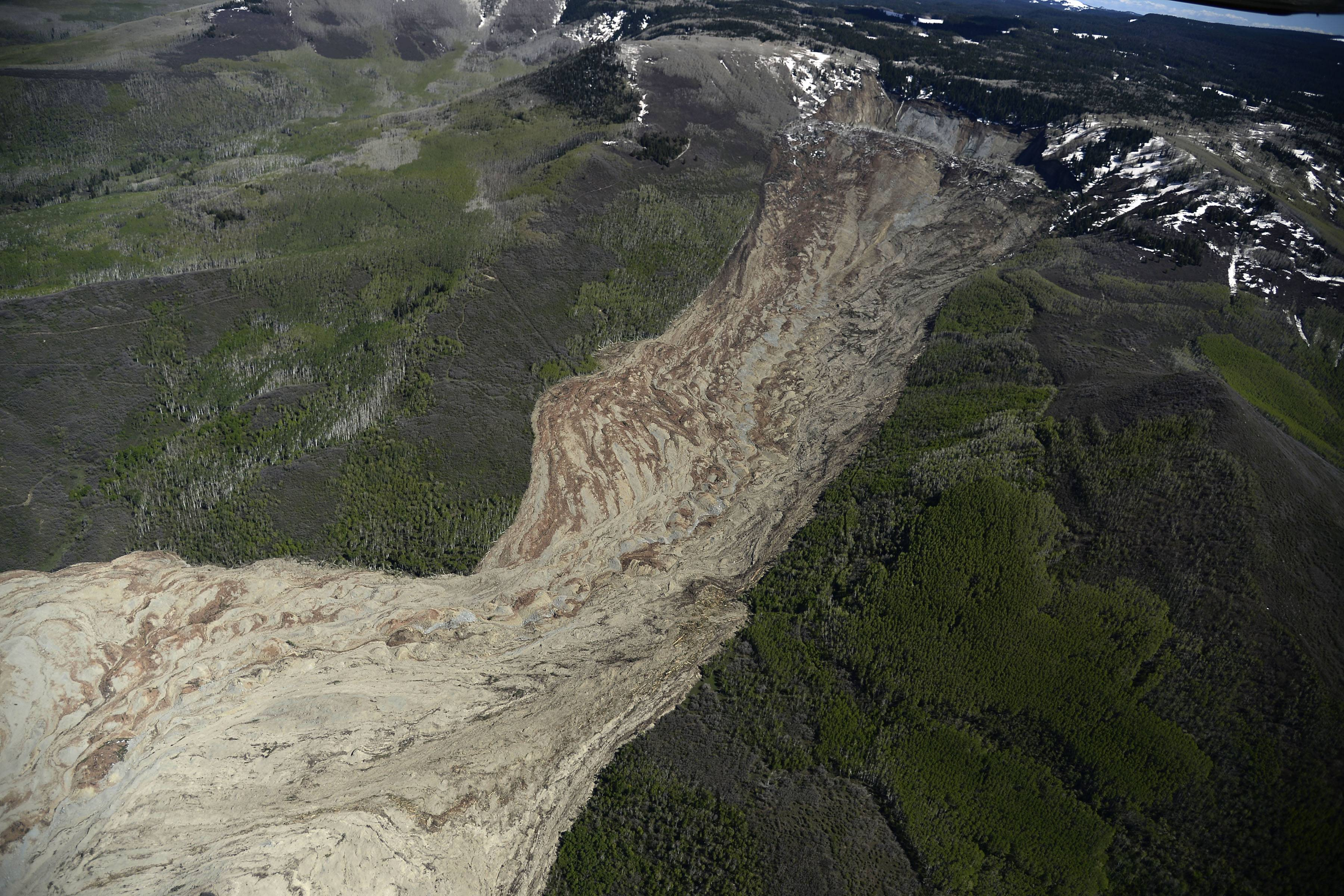 The aftermath of the Mesa County Mudslide is photographed from a plane, Monday, May 26, 2014, near Collbran, Colo. Rescue teams are searching for three men missing after a half-mile stretch of a ridge saturated with rain collapsed.