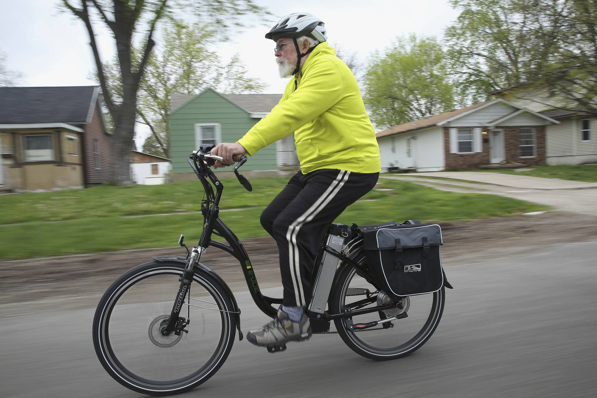 David Lasley rides his electric bike in Springfield. He uses his customized electric bicycle to commute between his north-end Springfield home and work.