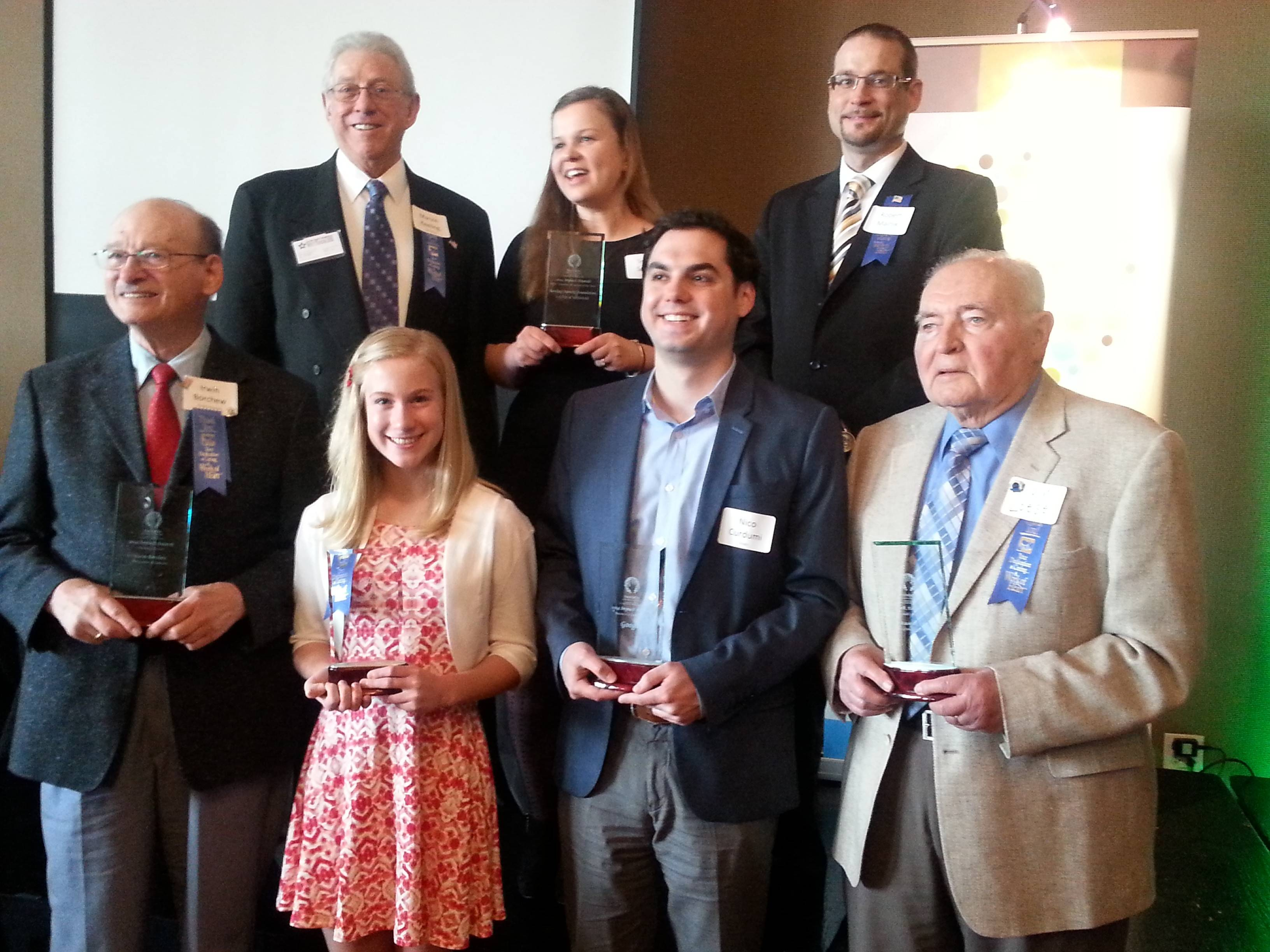 Winners of the 2014 Impact Awards are, back row, from left, Marvin Keeling, Sylvia Smaga and Rob Malnik. Front row, from left, Irwin Borchew, Jess Streepy, Nico Curdumi, Al Loesel. Not pictured: Lori Nowacki.