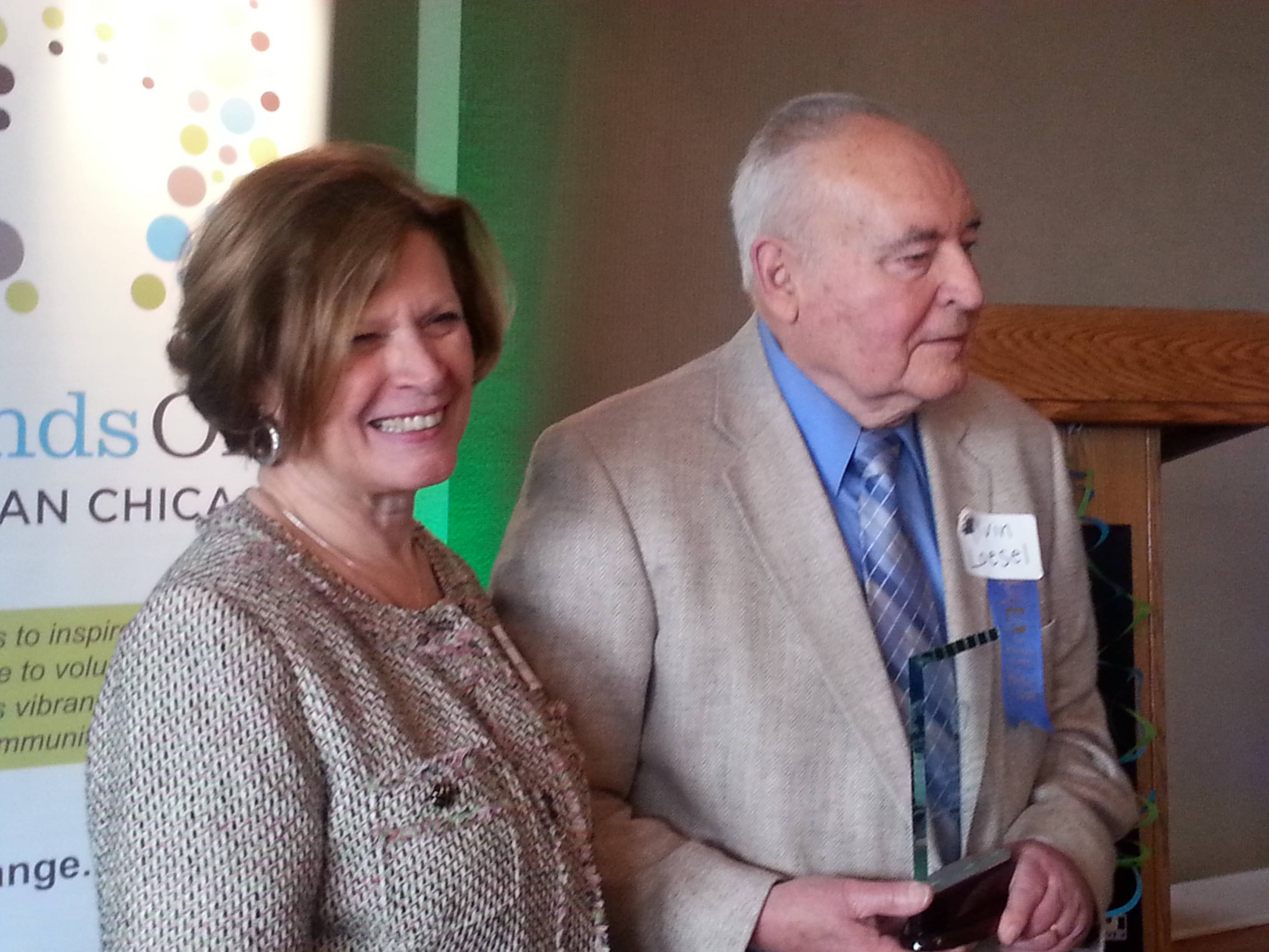 Christine Smith, executive director of HandsOn Suburban Chicago, with Impact Award winner Al Loesel.