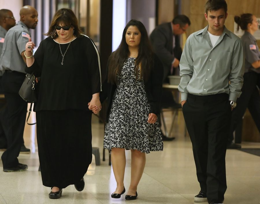 Carly Rousso walks into the Lake County courthouse with family and friends Tuesday for her trial on charges of aggravated DUI and reckless homicide. Rousso is charged with running over and killing 5-year-old Jaclyn Santos-Sacramento in Highland Park in 2012.