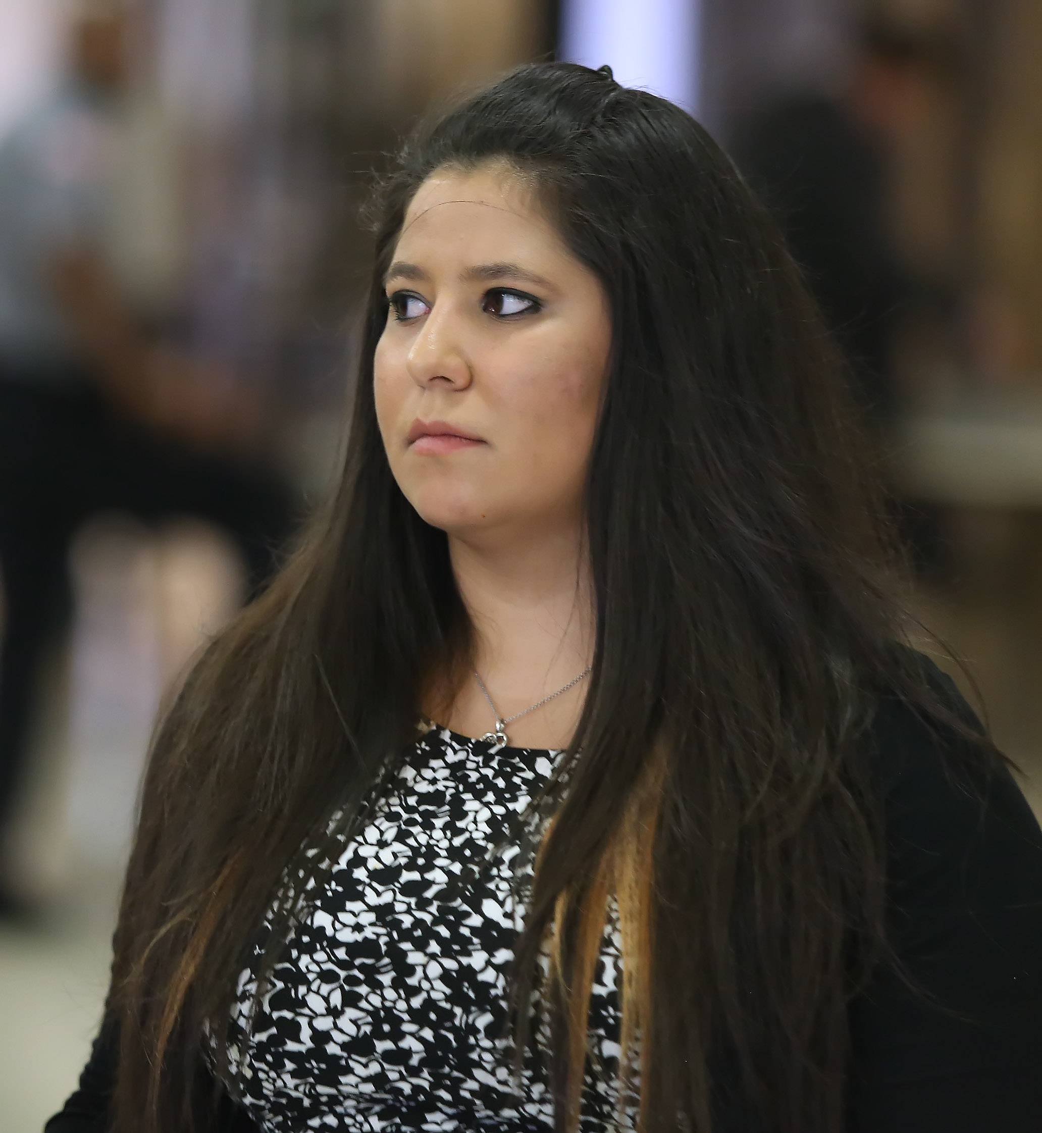 "Carly Rousso walks into the Lake County courthouse with family and friends Tuesday for her trial on charges of aggravated DUI and reckless homicide. Rousso is charged with running over and killing 5-year-old Jaclyn Santos-Sacramento in Highland Park in 2012 after authorities said she was ""huffing"" computer dust cleaner."