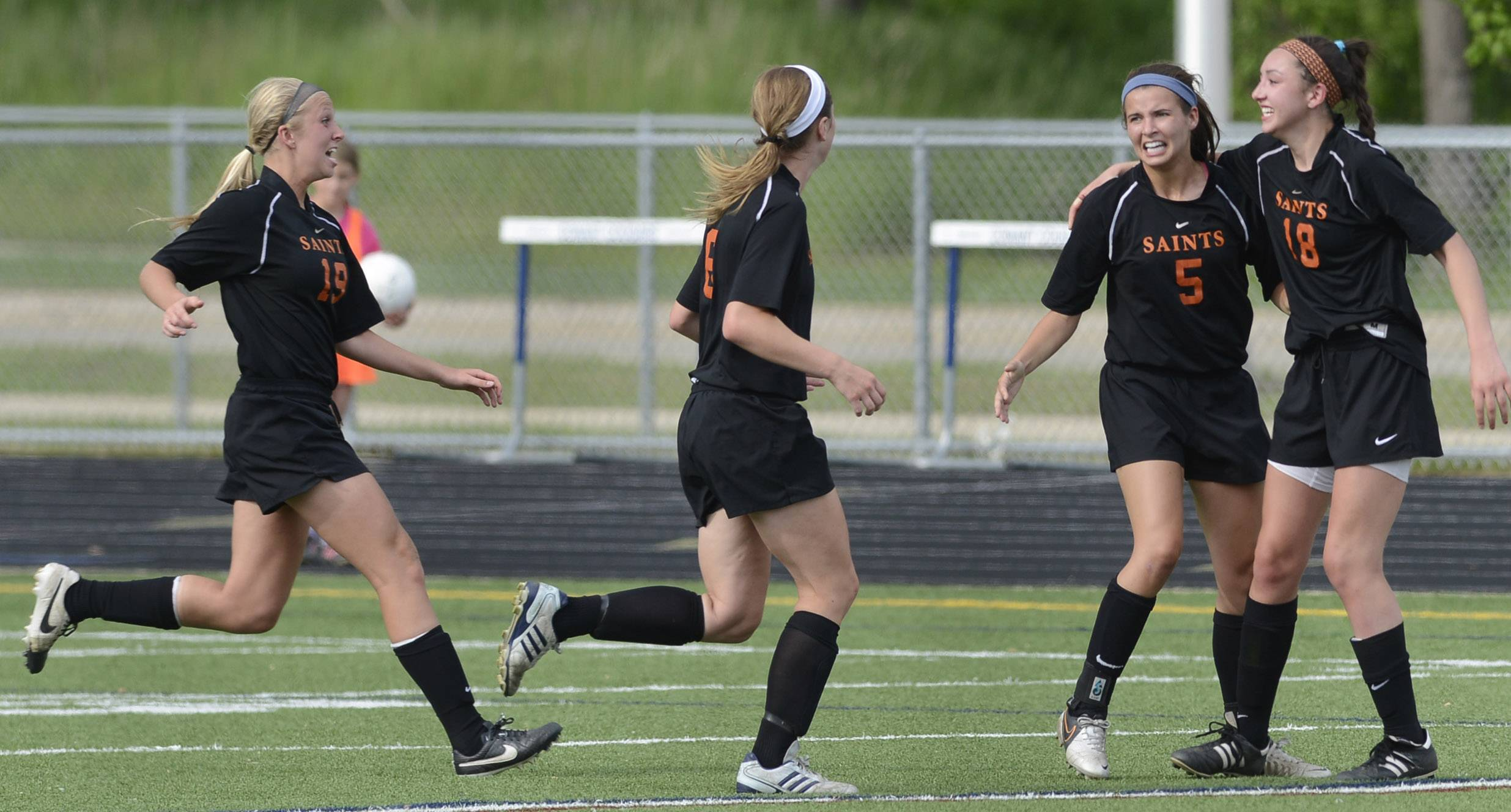 From left to right, St. Charles East's Sophie Jendrzeczyk, Kelli Santo Paolo, Shannon Rasmussen and Mallory Mollenhauer celebrate their team's second goal of the first half at the Class 3A Conant sectional semifinal against St. Charles North in Hoffman Estates Tuesday.