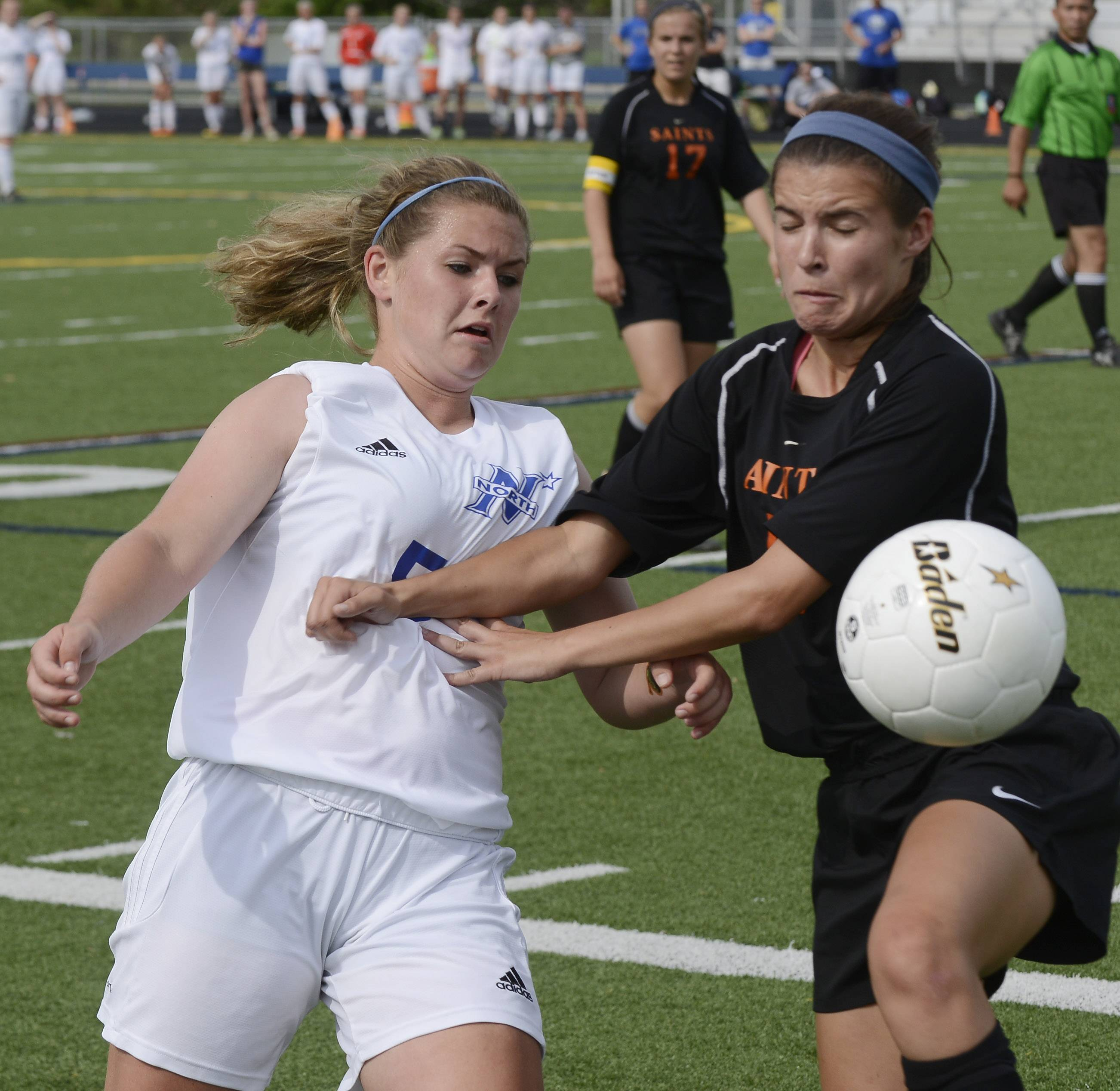 Hannah Durocher, left, of St. Charles North and Shannon Rasmussen of St. Charles East battle for the ball Tuesday.