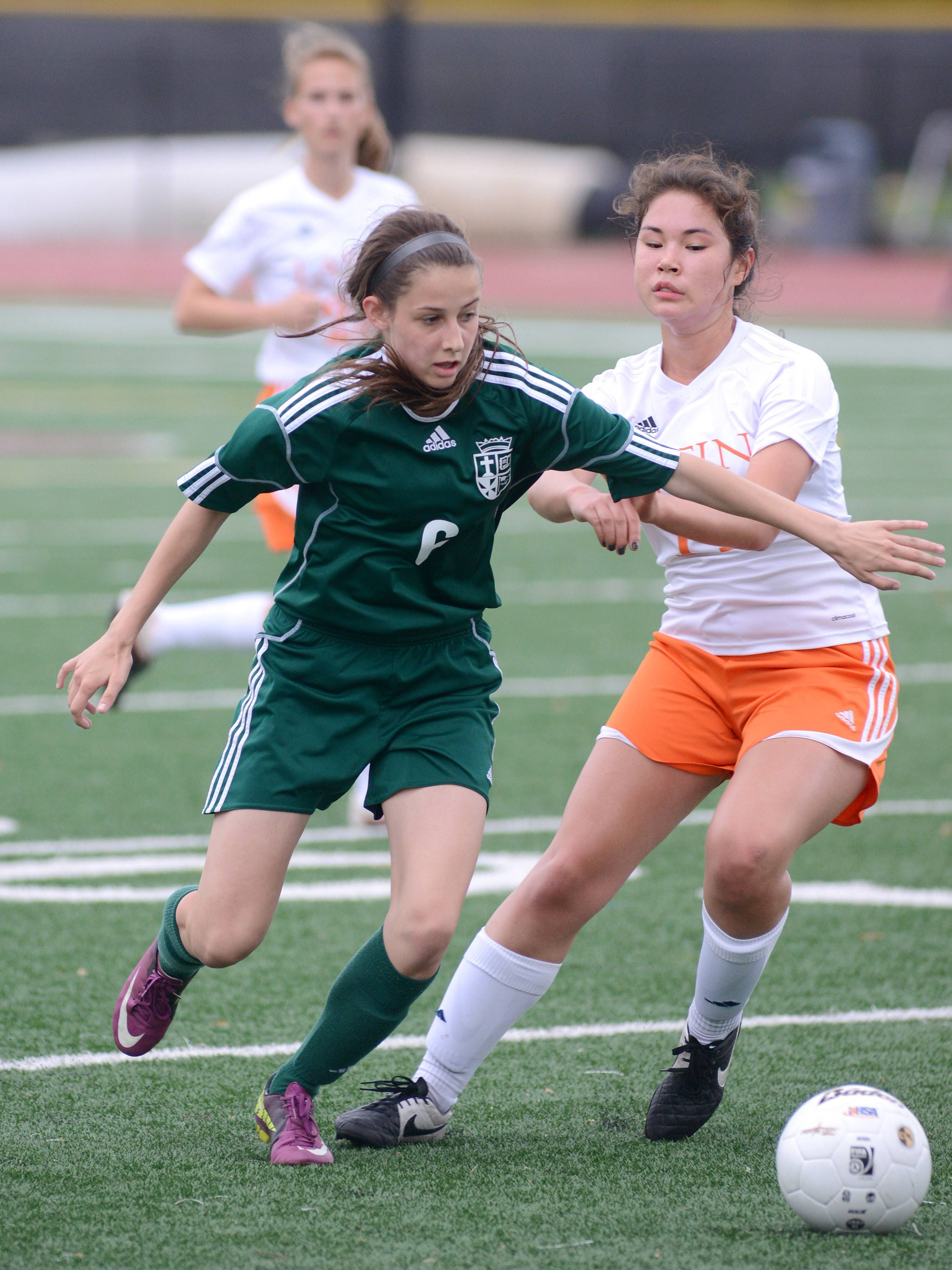 St. Edward's Chelsea Gnan, left, and Chicago Latin's Jane Aguler battle for the ball in the first half of the Class 1A supersectional at Concordia University in River Forest on Tuesday, May 27.