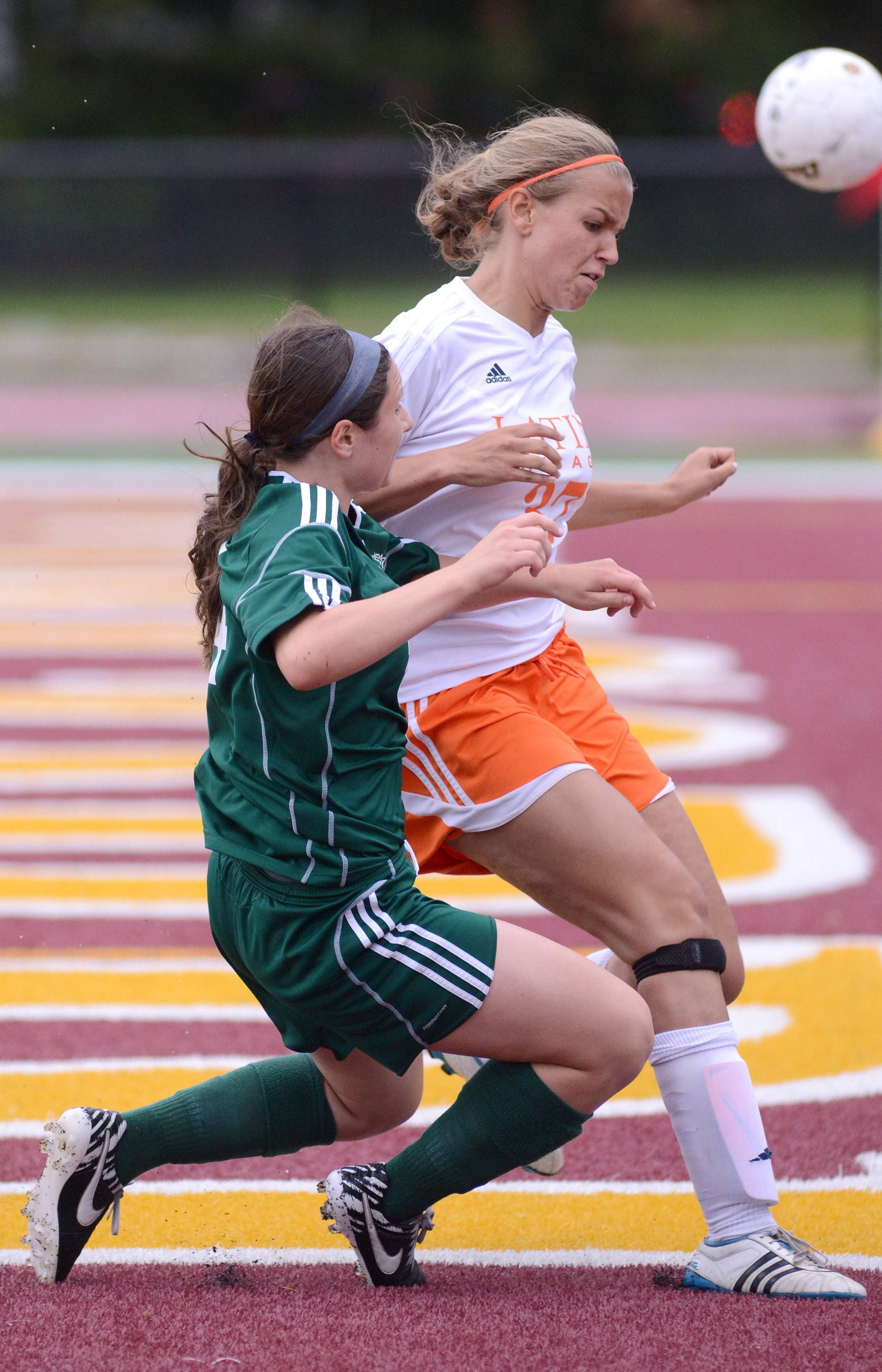 St. Edward's Alex Zeller, left, and Chicago Latin's Morgan Sulger collide while battling for the ball near the net in the second half of the Class 1A supersectional at Concordia University in River Forest on Tuesday, May 27.