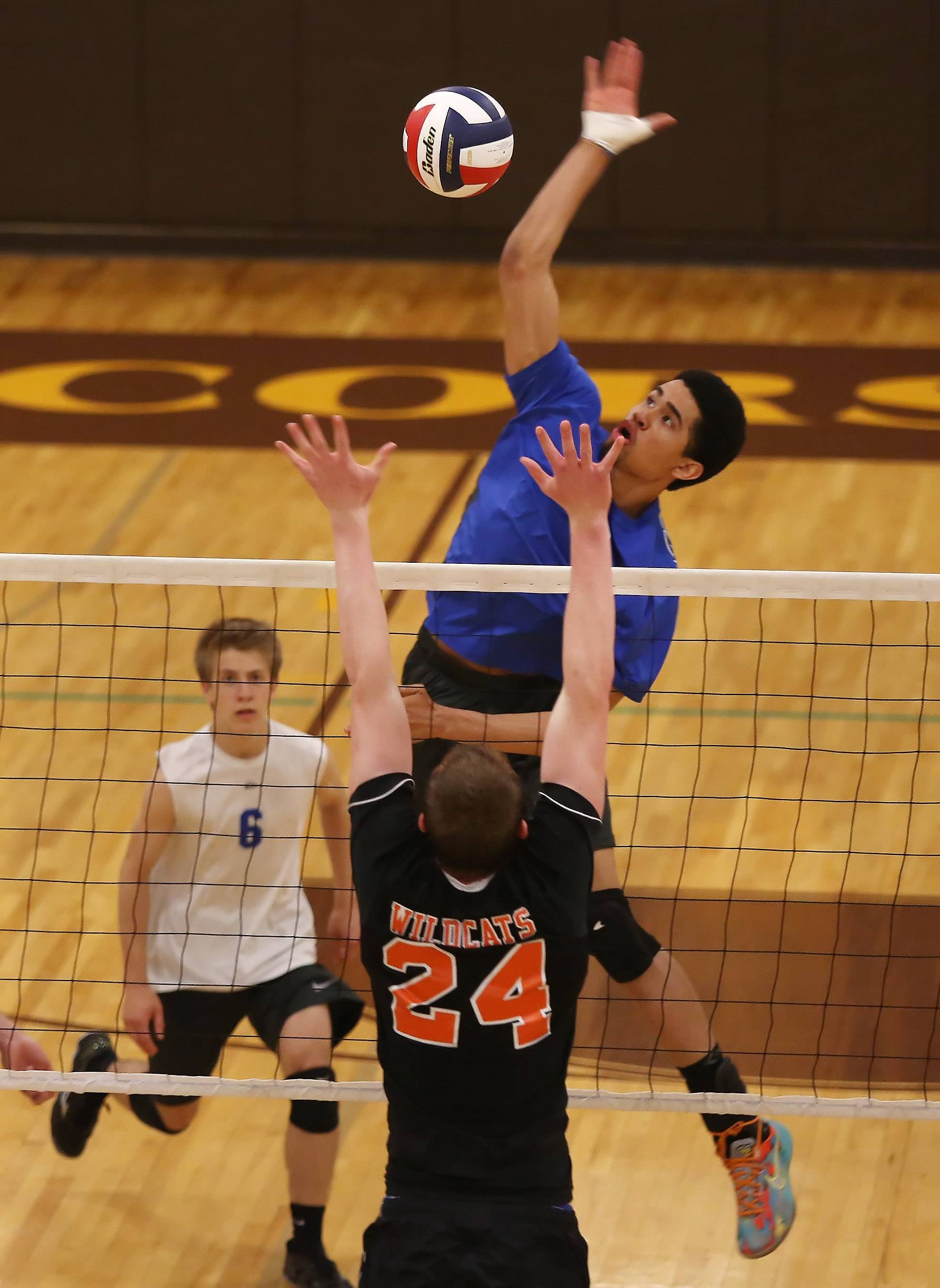 Vernon Hills' Lem Turner spikes the ball against Libertyville player Peter Feely during regional play Tuesday at Carmel.