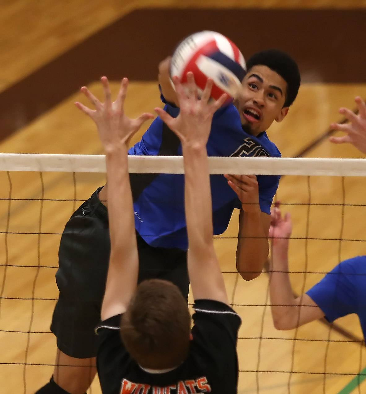 Vernon Hills hitter Lem Turner spikes the ball during regional semifinal play Tuesday at Carmel.