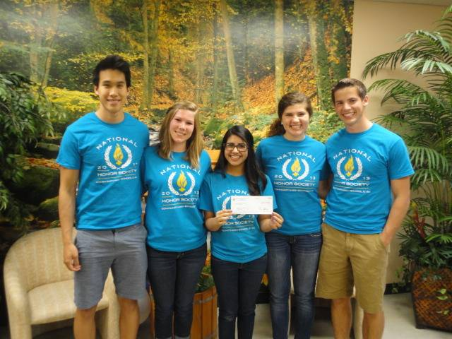 The NHS officers of West Chicago Community High School at HSP headquarters with their donation. From left to right: Sean Young, Treasurer; Kristen Thompson, Induction Chair; Janaki Thakker, President; Emma Knoelke, Vice President; Eric Knoelke, Chairman for the Mother's Day Pancake Breakfast.Humanitarian Service Project