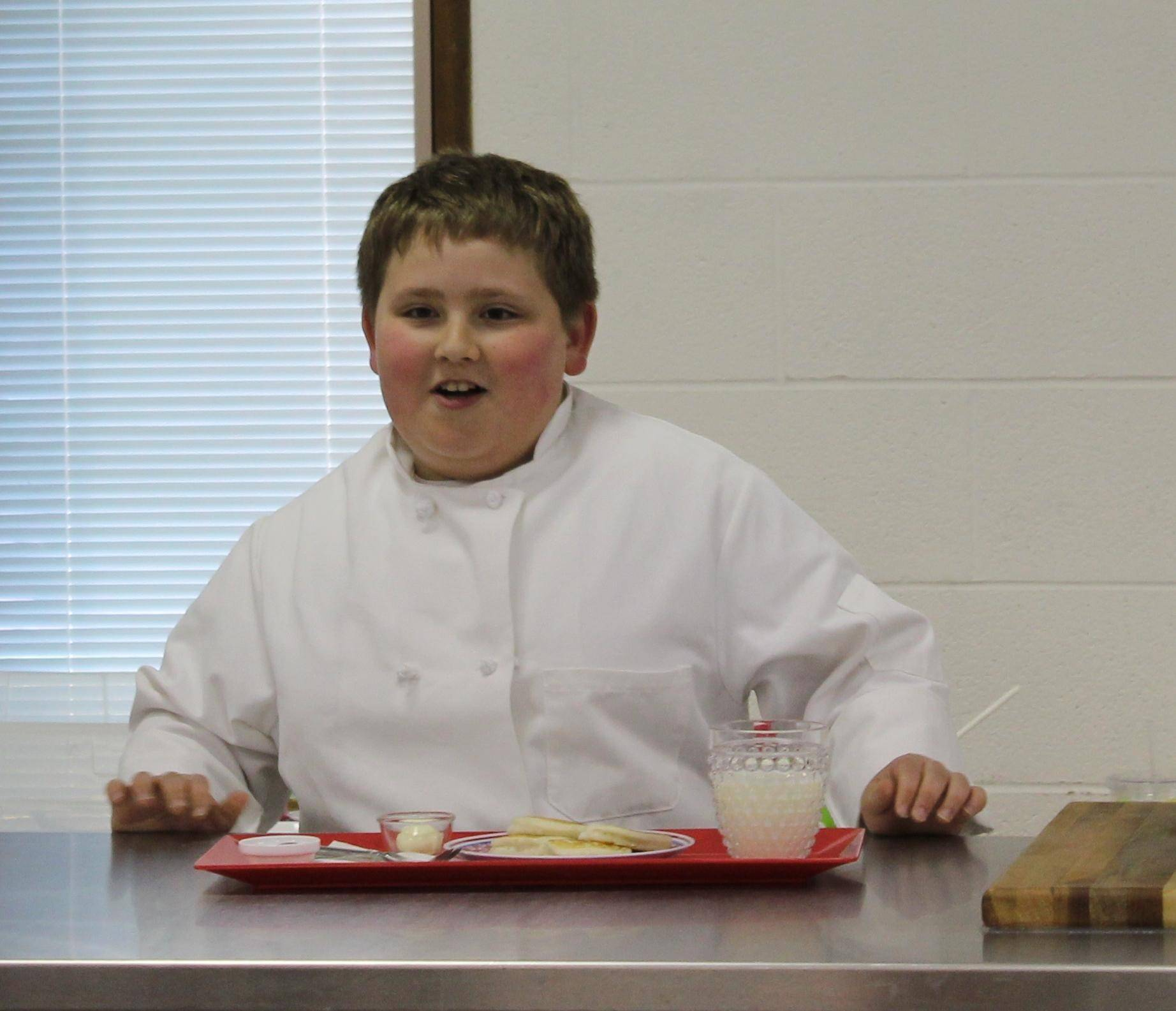 Ely Greenfield of Elgin took home grand champion food demonstration honors with a how-to speech on baking biscuits. He mixed the batter and cooked the treats right in front of the audience. He said it was his grandmother's special recipe.