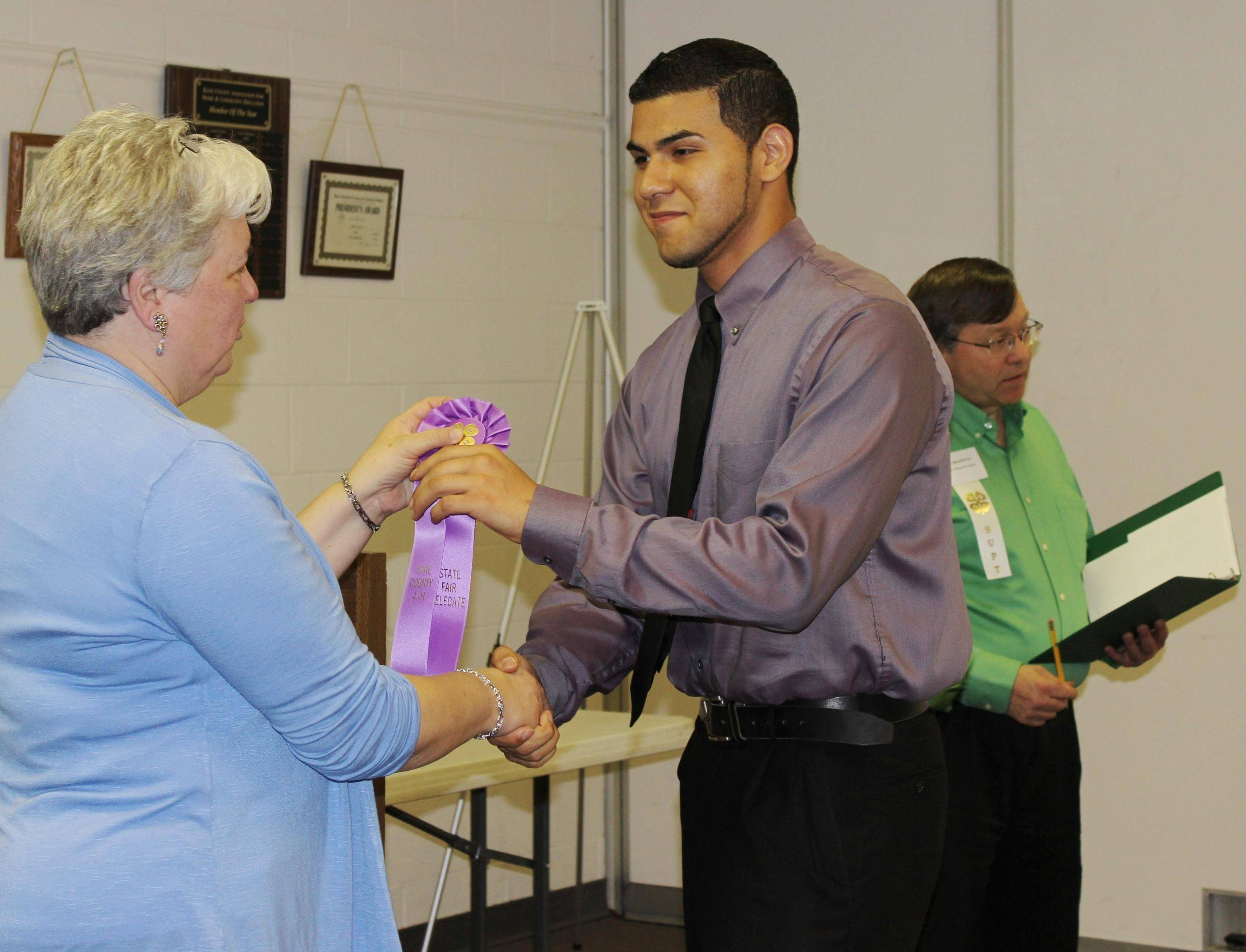 4-H'er Marcos Marquez of St. Charles earned a ticket to the state competition with his illustrated speech in the Kane County competition. Marquez spoke about physical training with both aerobic and anaerobic techniques.