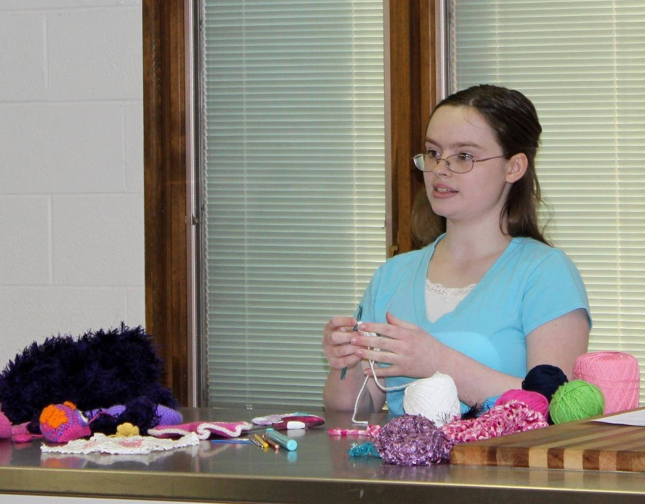 Emily Smeenge of Rolling Meadows demonstrates crochet techniques during the Kane County 4-H Public Presentation and Demonstration Contest on May 9. She went on to win State Fair Delegate in the formal speech category.