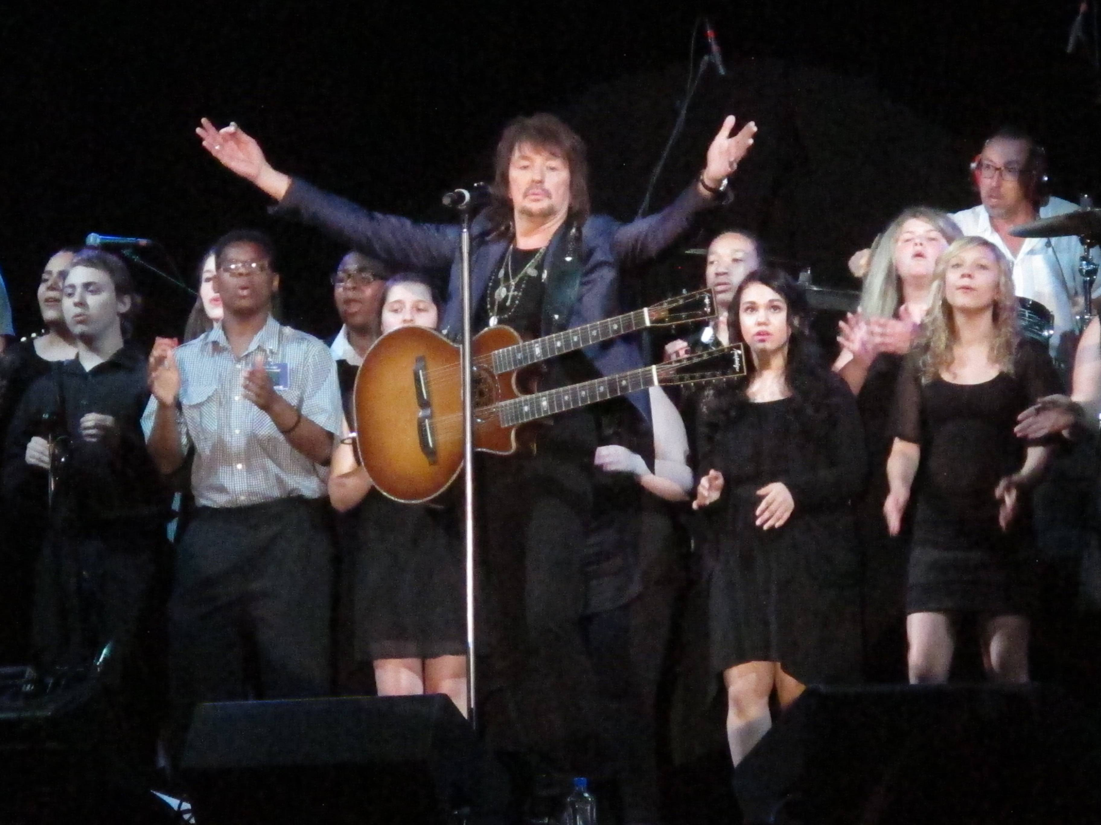 "Bon Jovi guitarist Richie Sambora performs the new song, ""Lighthouse,"" at an anti-drug forum in Toms River, N.J., on Tuesday. The song will raise money for a drug-treatment center in New Jersey."