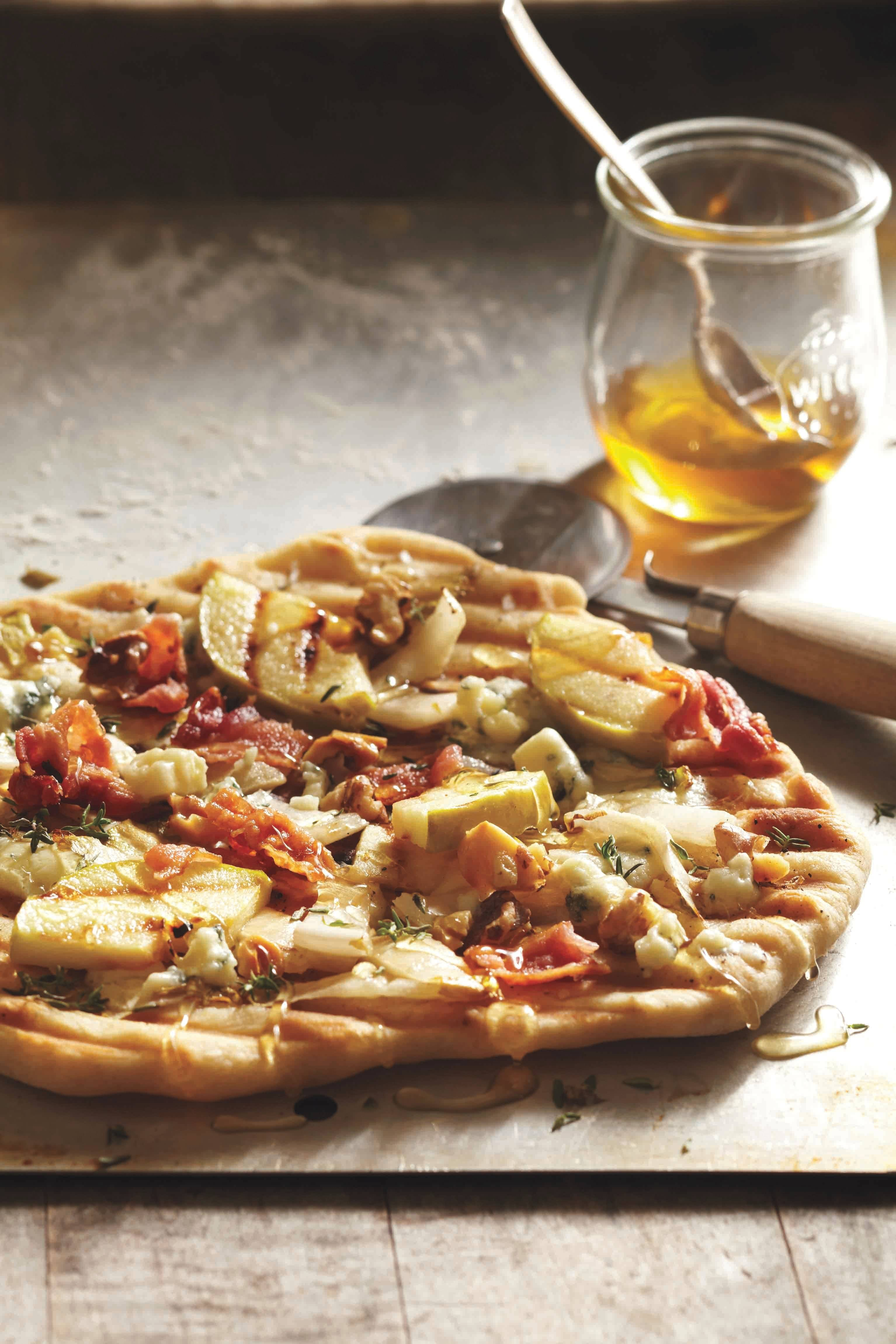 Endive and apples hit the flames before topping a blue cheese- and bacon-studded grilled pizza.