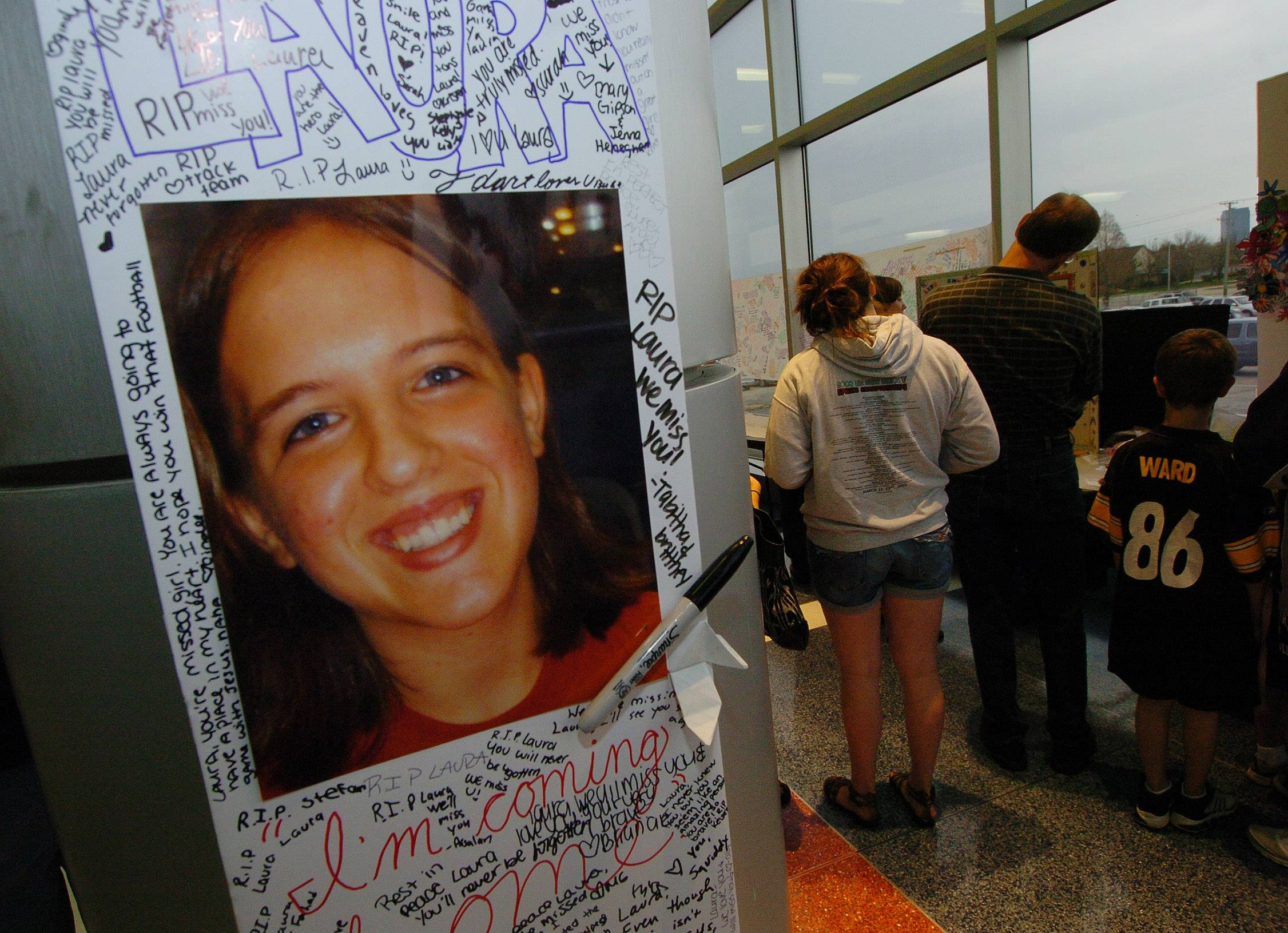 Tributes from students frame a photo of Laura Engelhardt at Conant High School in Hoffman Estates shortly after she was killed in 2009.