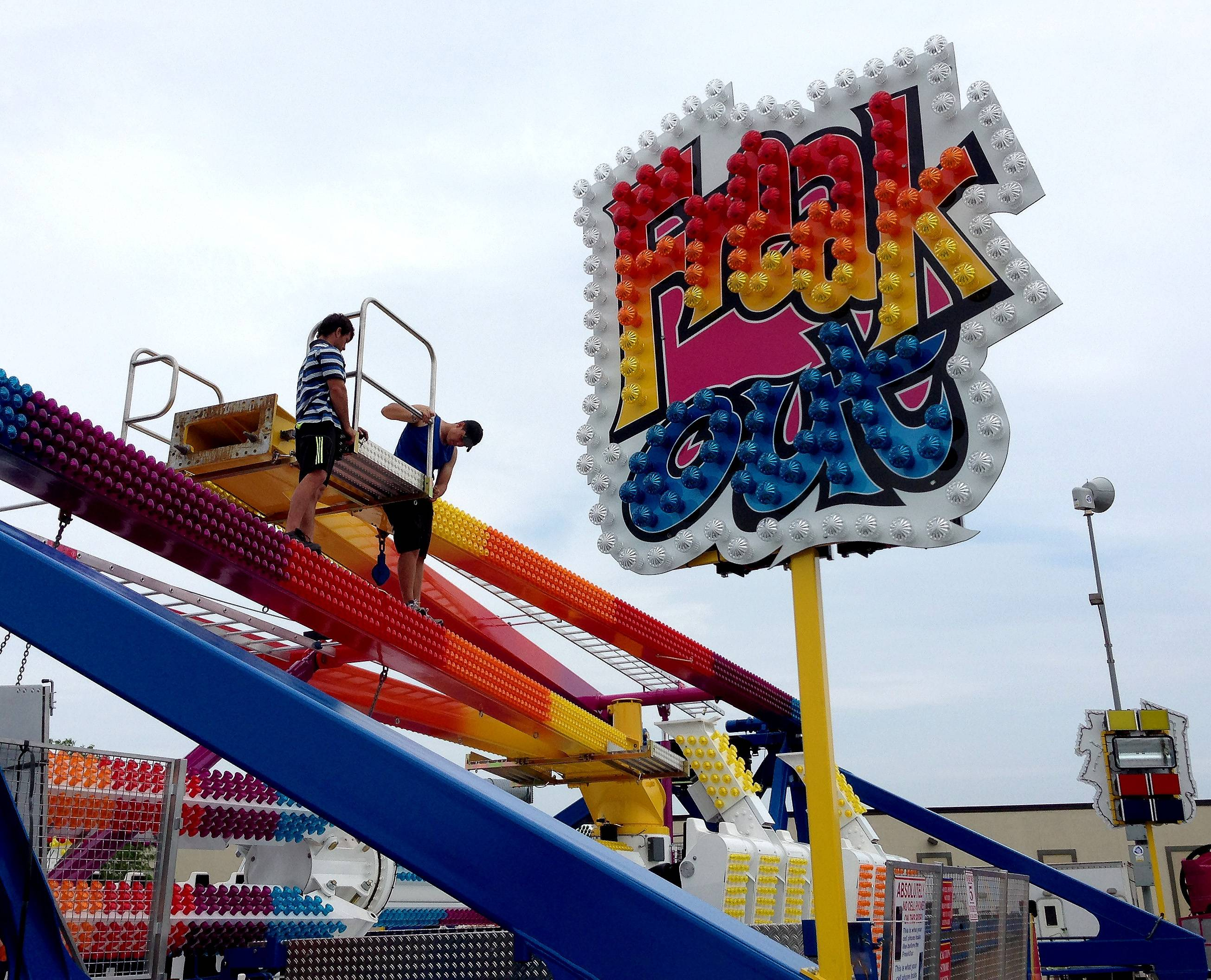 Crews set up the Freak Out ride Wednesday in preparation for the Roselle Lions Club's annual Rose Fest. The celebration opens Thursday and runs through Sunday in the village's train station parking lot.
