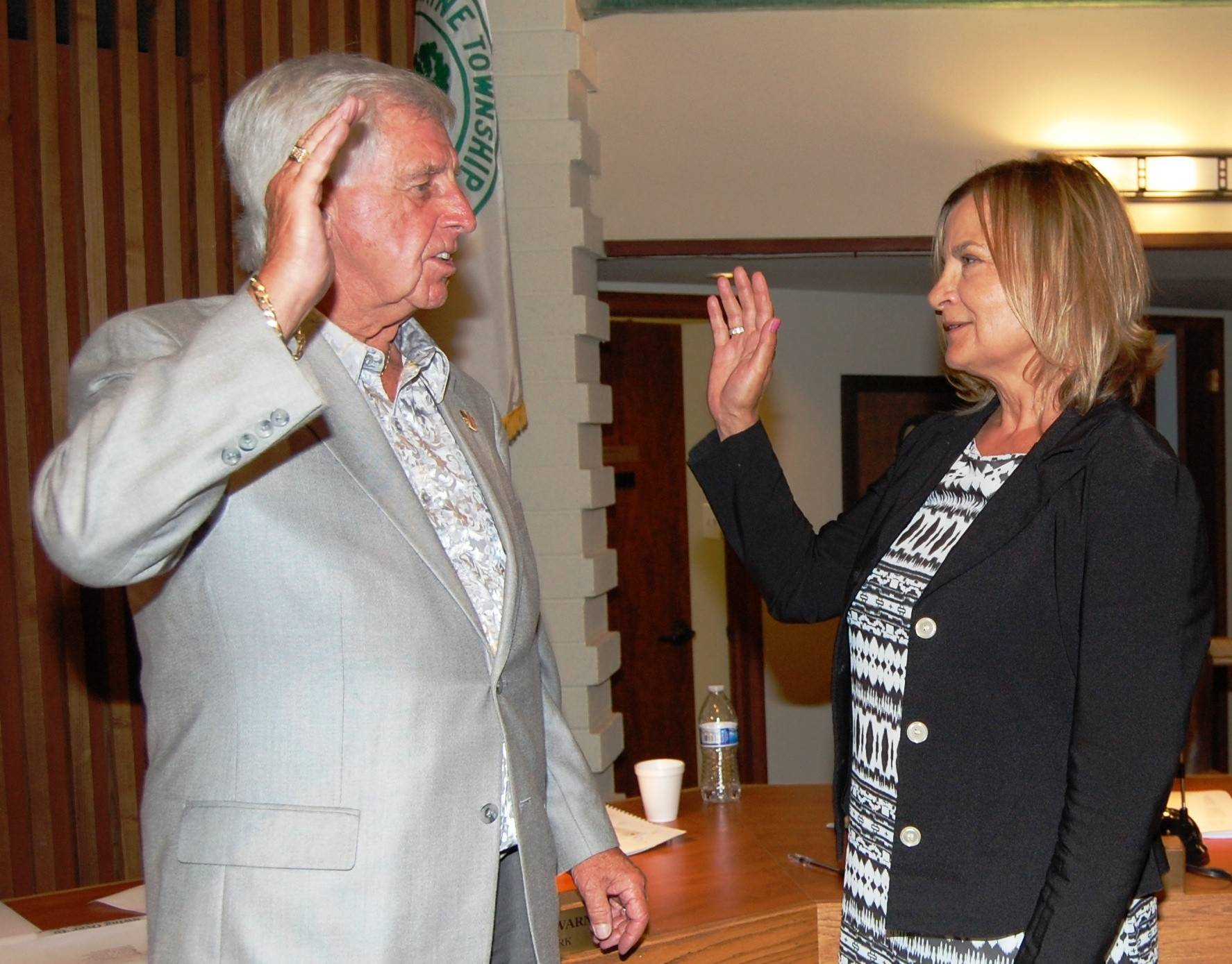 Maine Township Clerk Gary Warner swears in Susan Moylan Krey as township assessor Tuesday night.