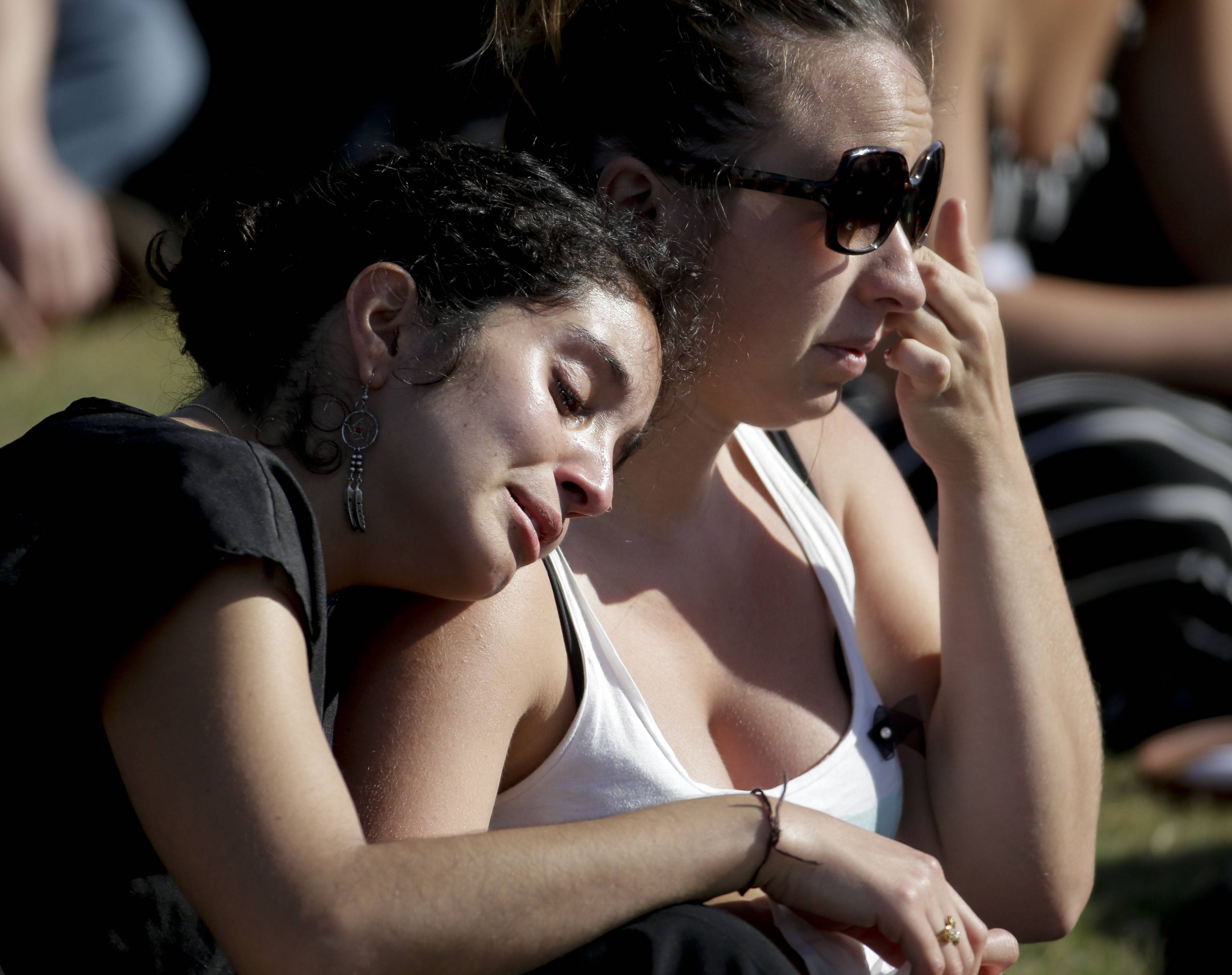 Students cry during a memorial service for the victims and families of Friday's rampage at Harder Stadium on the campus of University of California, Santa Barbara on Tuesday in the Isla Vista area near Goleta, Calif.