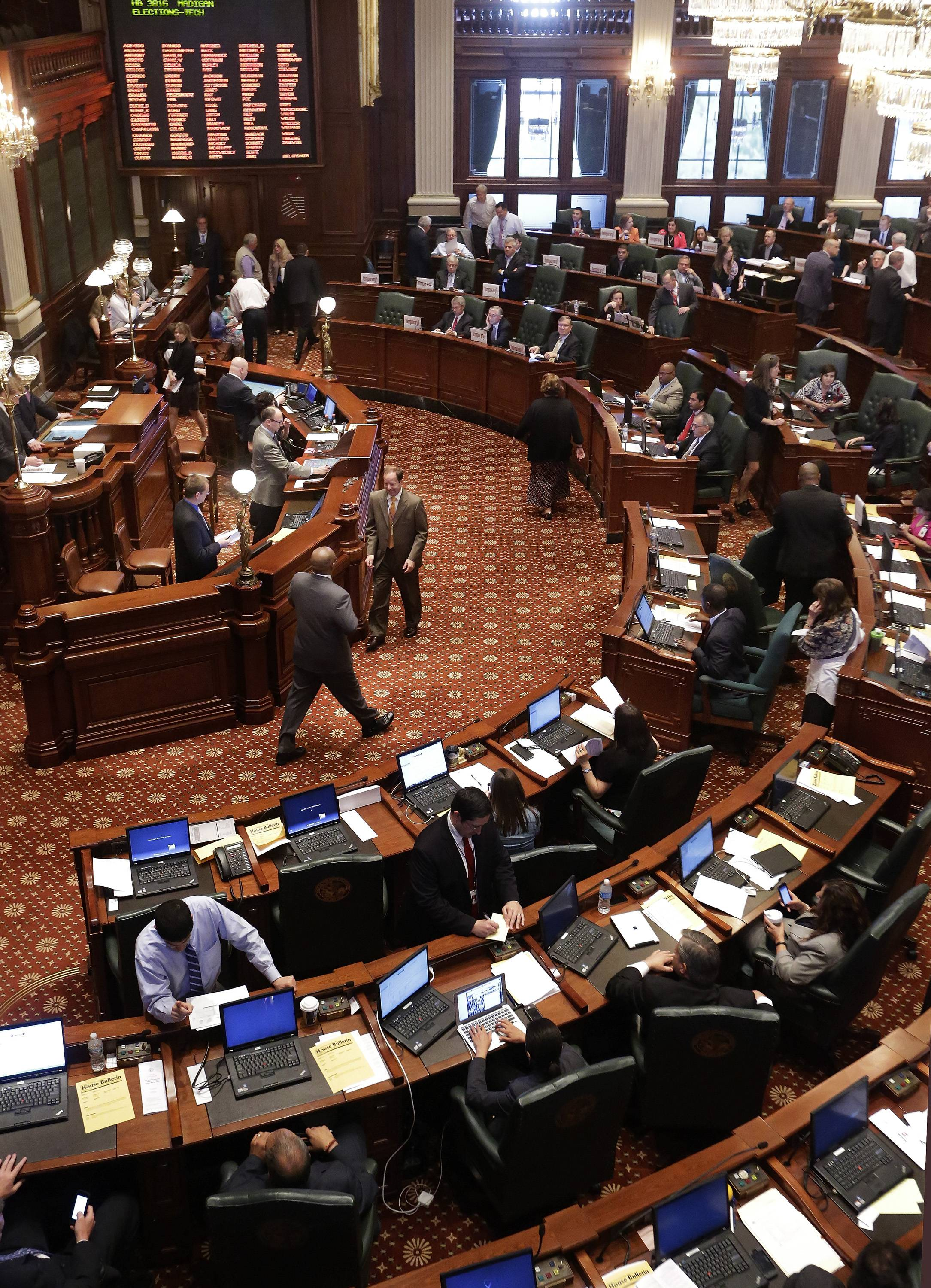 Lawmakers argue state budget legislation while on the House floor during session at the Illinois State Capitol in Springfield.