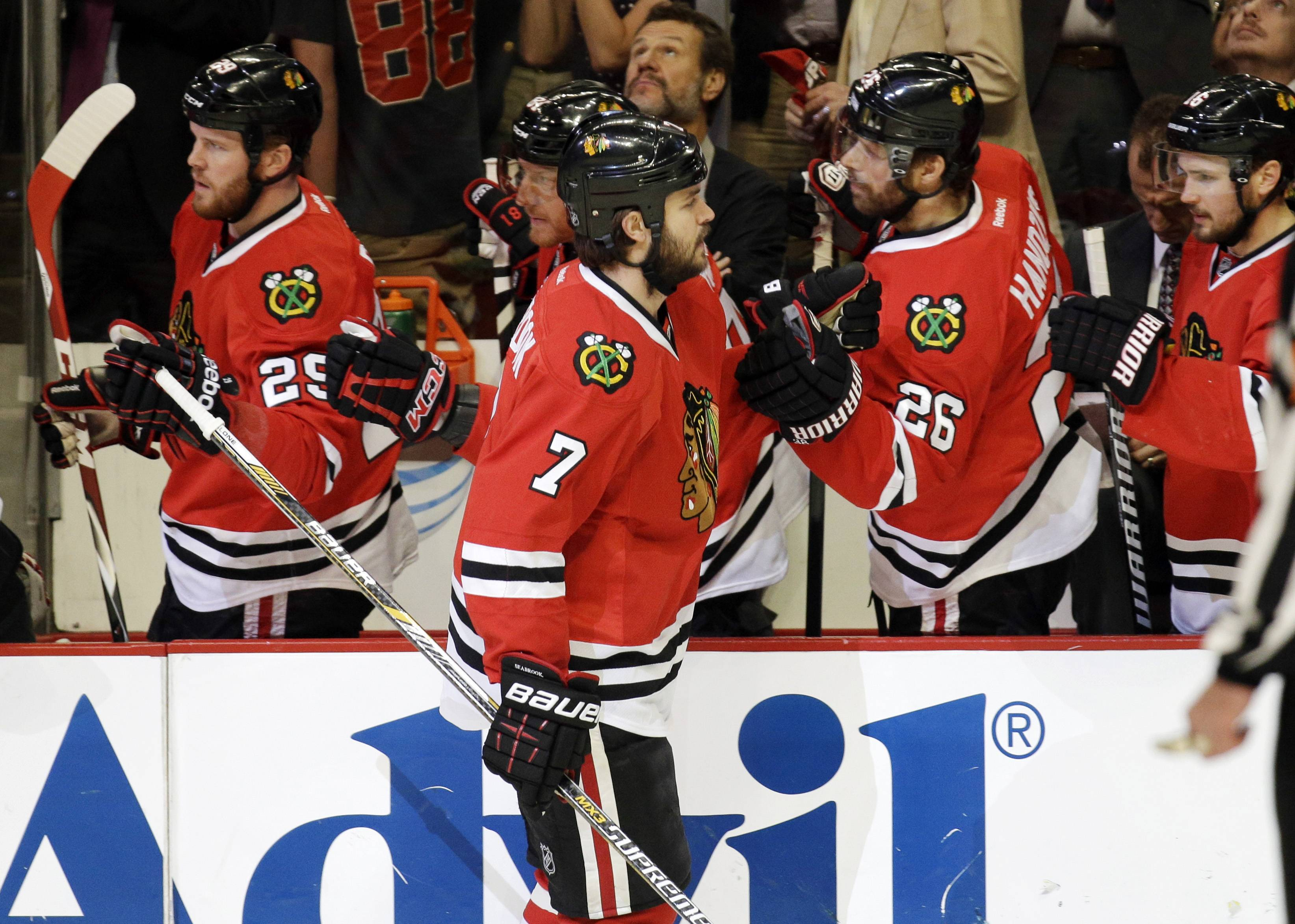 Chicago Blackhawks defenseman Brent Seabrook celebrates a goal with his teammates during the first period in Game 5 of the Western Conference finals against the Los Angeles Kings in the NHL hockey Stanley Cup playoffs Wednesday, May 28, 2014, in Chicago. (AP Photo/Nam Y. Huh)